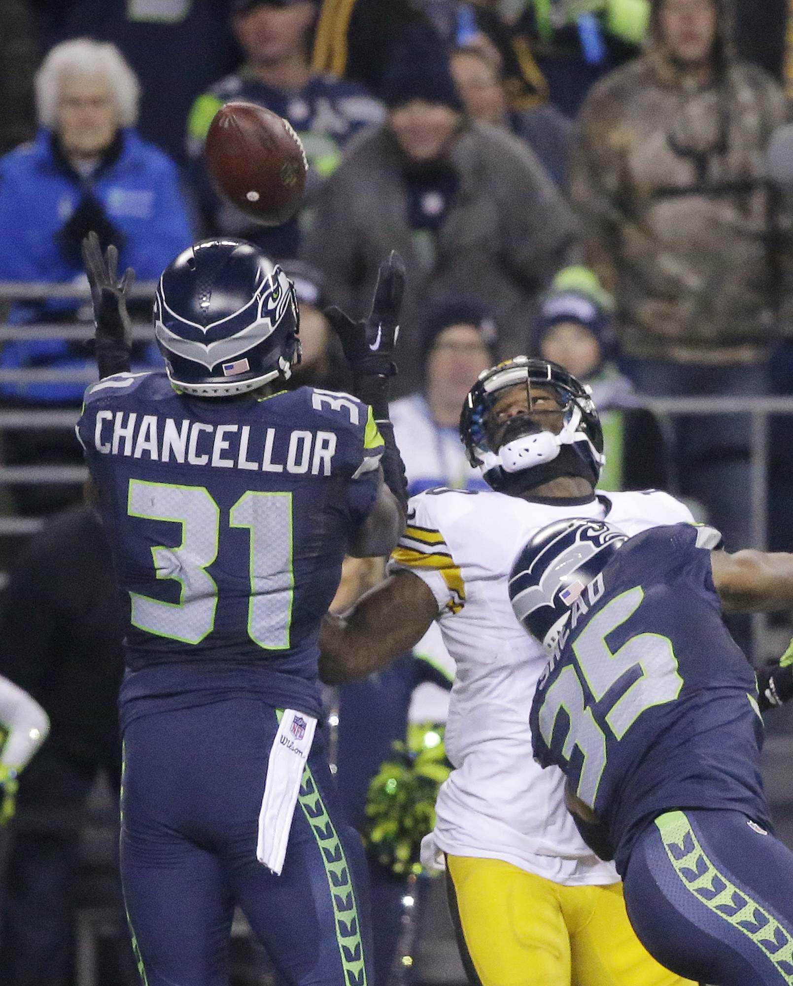Seattle Seahawks' Kam Chancellor (31) reaches to intercept a pass meant for Pittsburgh Steelers' Martavis Bryant in the second half of an NFL football game, Sunday, Nov. 29, 2015, in Seattle. Seahawks' DeShawn Shead is at right. The Seahawks won 39-30. (A