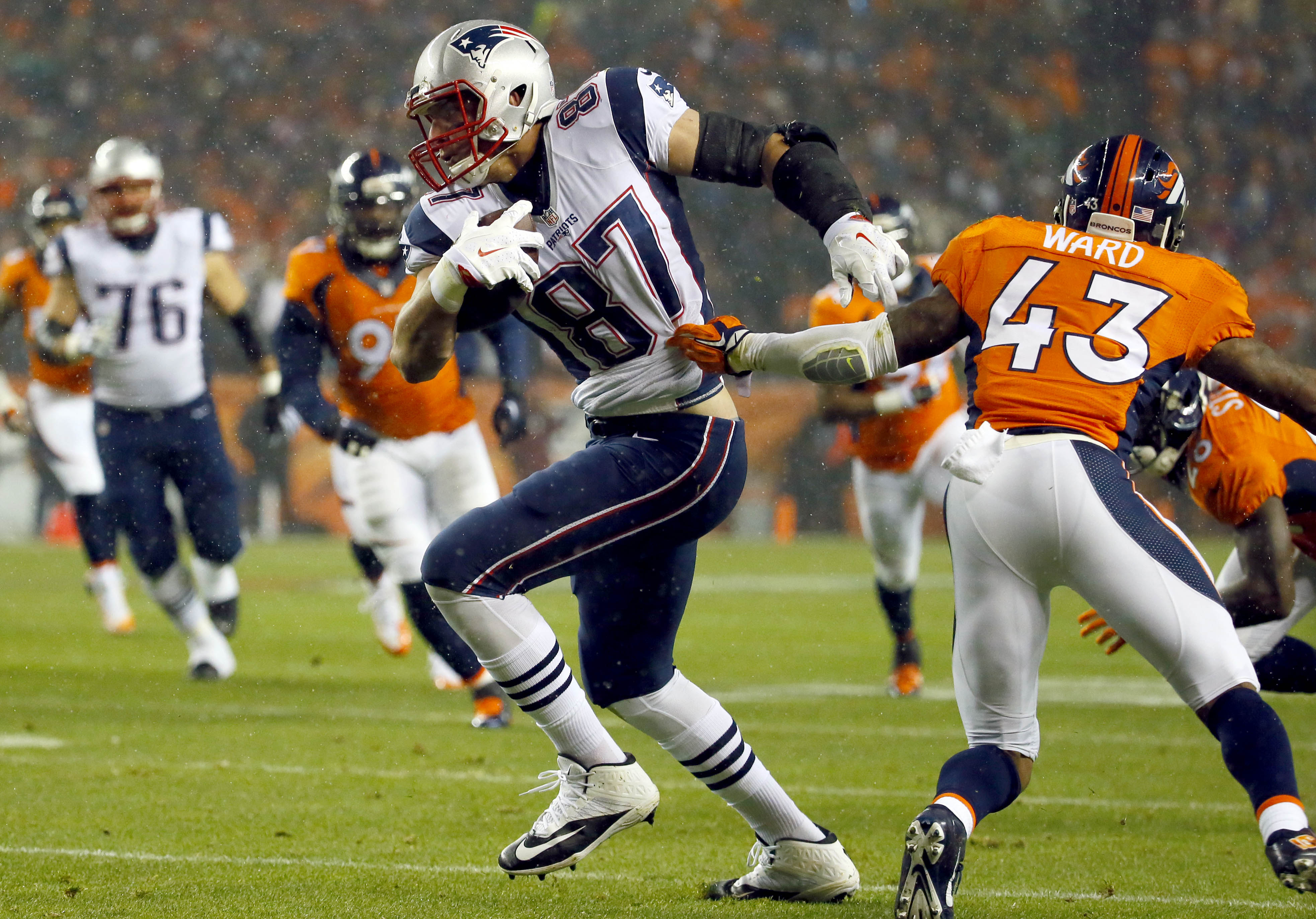 New England Patriots tight end Rob Gronkowski (87) breaks free from Denver Broncos strong safety T.J. Ward (43) for a touchdown during the first half of an NFL football game, Sunday, Nov. 29, 2015, in Denver. (AP Photo/Jack Dempsey)