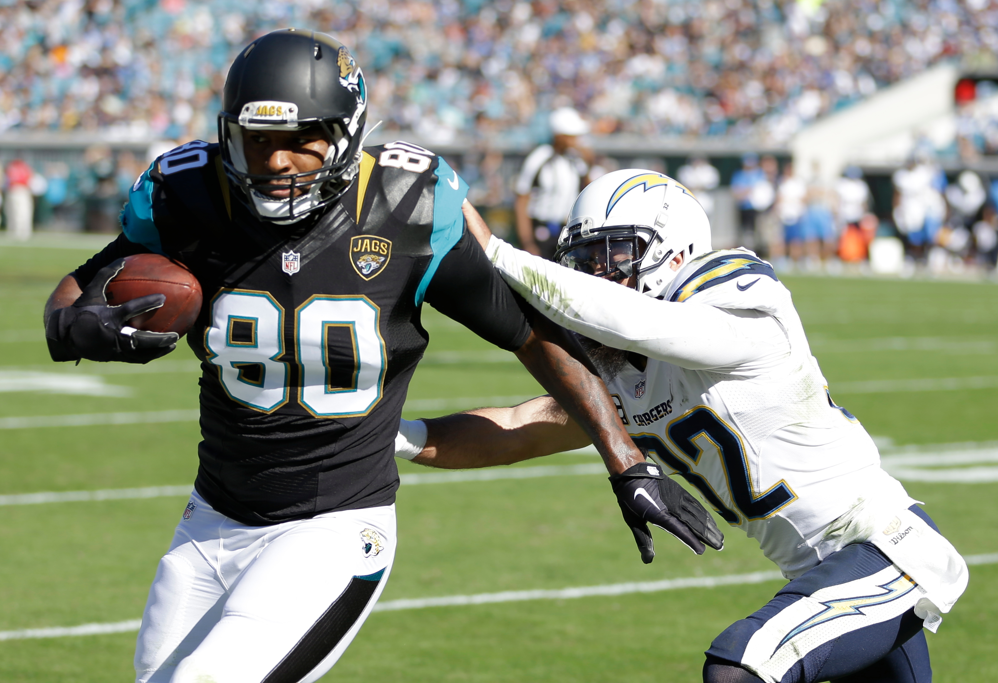 FILE - In this Nov. 29, 2015, file photo, Jacksonville Jaguars tight end Julius Thomas (80) is pushed out of bounds by San Diego Chargers free safety Eric Weddle (32) after a reception during the first half of an NFL football game in Jacksonville, Fla. Th