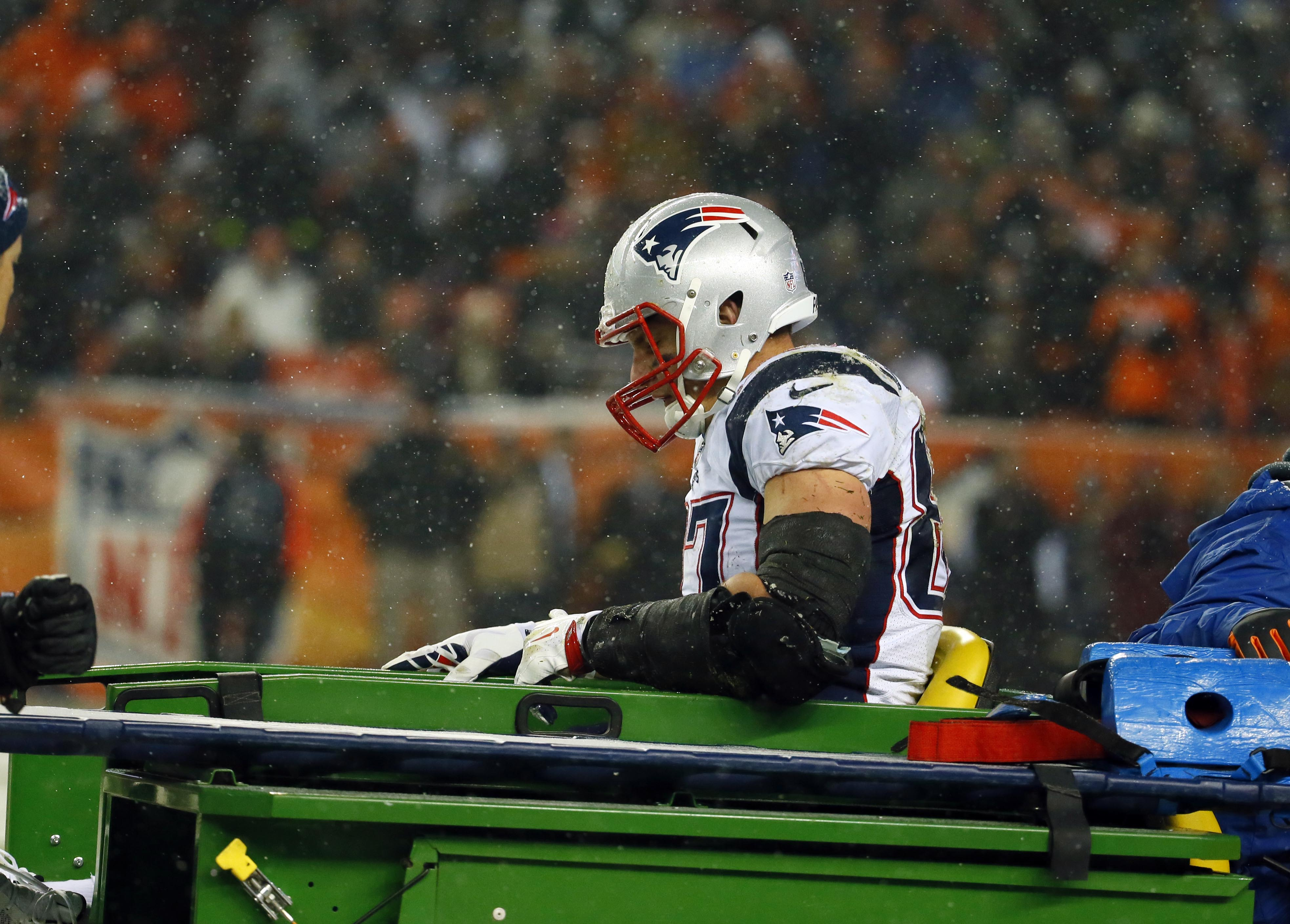 FILE - In this Nov. 29, 2015, file photo, New England Patriots tight end Rob Gronkowski is carted off the field after being injured against the Denver Broncos during the second half of an NFL football game in Denver. In case you missed it in Week 12 of th