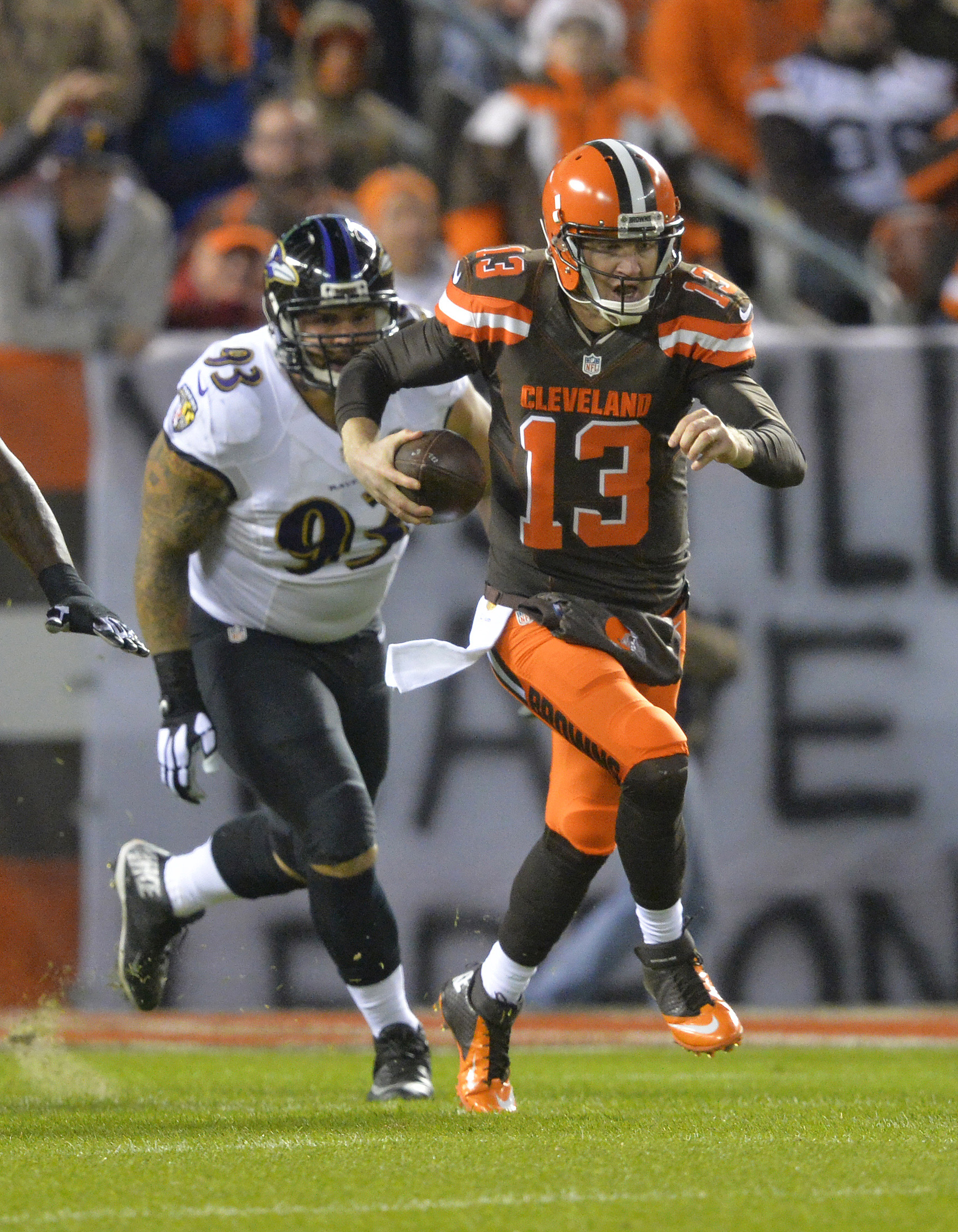 Cleveland Browns quarterback Josh McCown (13) outruns Baltimore Ravens defensive end Lawrence Guy (93) in the first half of an NFL football game, Monday, Nov. 30, 2015, in Cleveland. (AP Photo/David Richard)