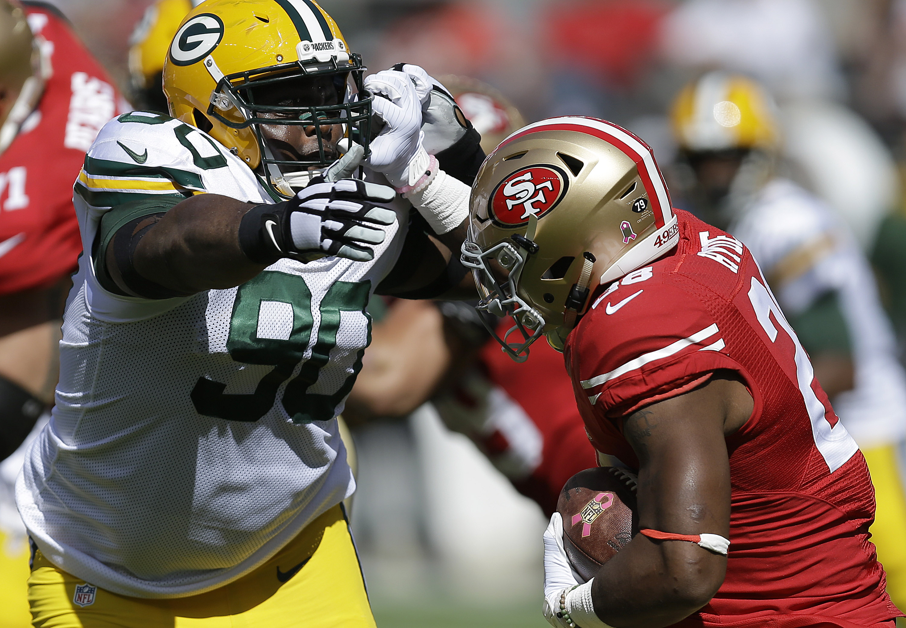 FILE - In this Oct. 4, 2015, file photo, Green Bay Packers nose tackle B.J. Raji (90) reaches for San Francisco 49ers running back Carlos Hyde during the first half of an NFL football game in Santa Clara, Calif. Problems on offense have overshadowed a sol