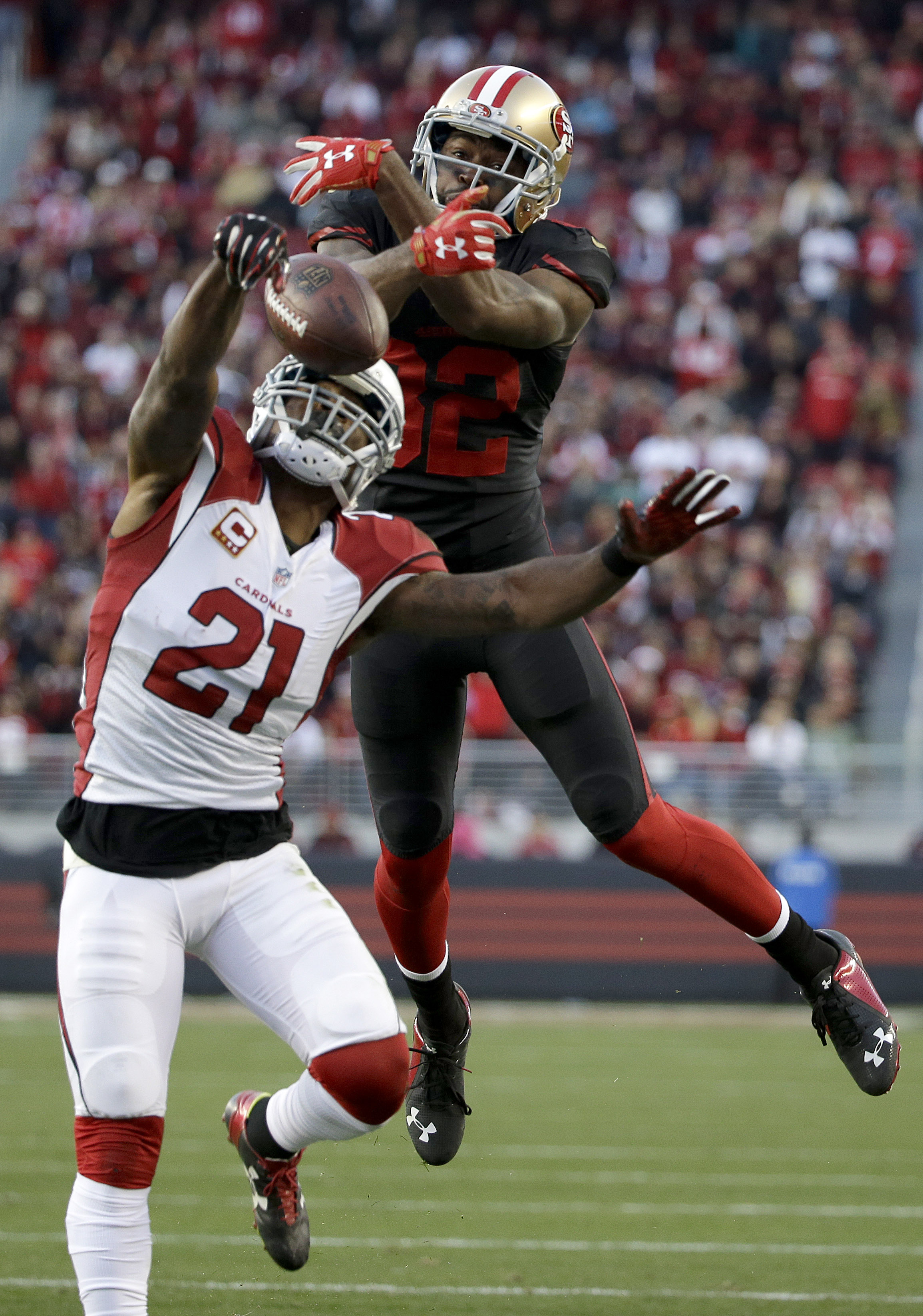 FILE - In this Nov. 29, 2015, file photo, Arizona Cardinals cornerback Patrick Peterson (21) breaks up a pass intended for San Francisco 49ers wide receiver Torrey Smith (82) during the second half of an NFL football game in Santa Clara, Calif. Tyrann Mat
