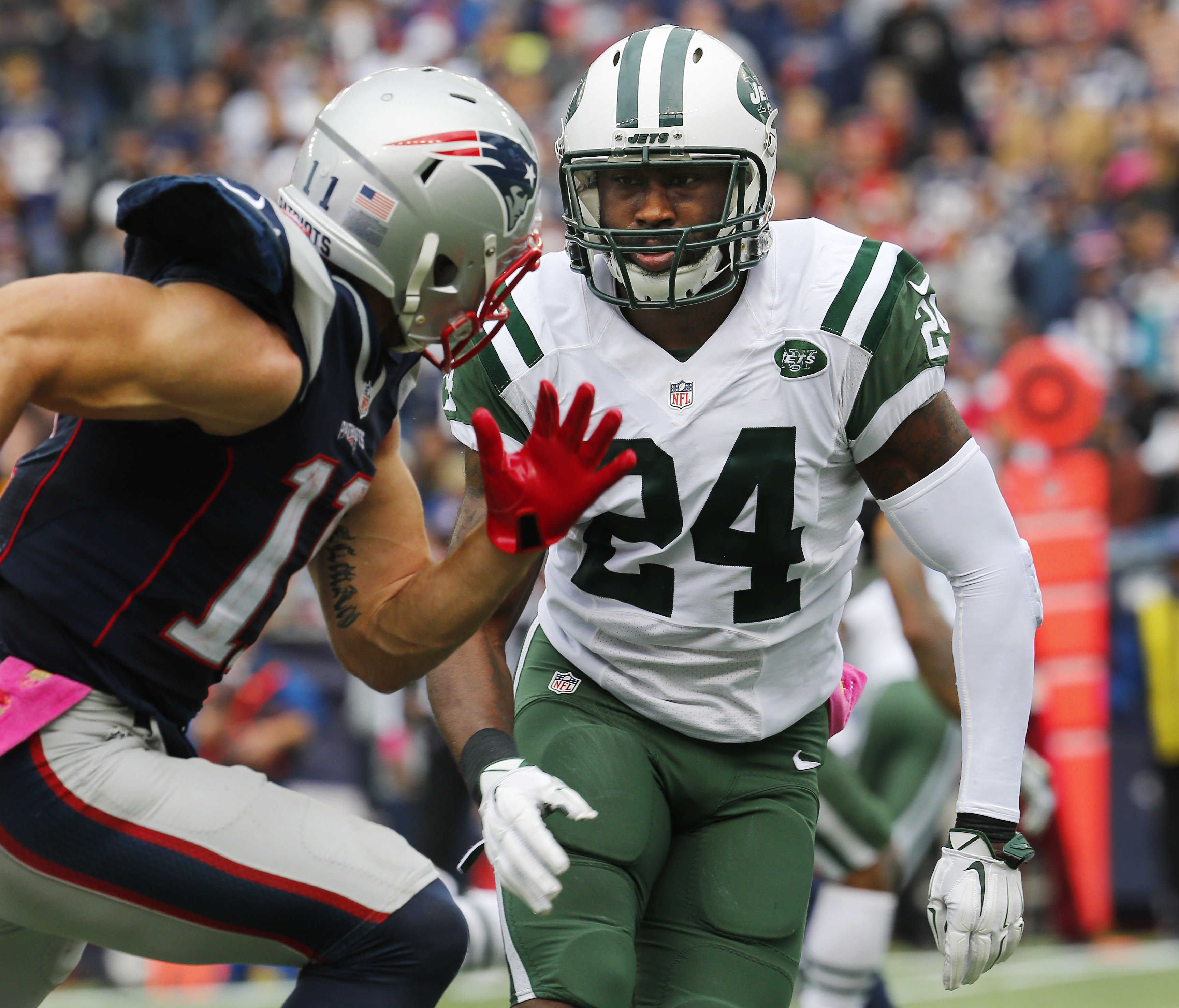 FILE - In this Oct. 25, 2015, file photo, New York Jets cornerback Darrelle Revis (24) covers New England Patriots wide receiver Julian Edelman during an NFL football game in Foxborough, Mass. The Jets are expected to get a better idea of cornerback Darre