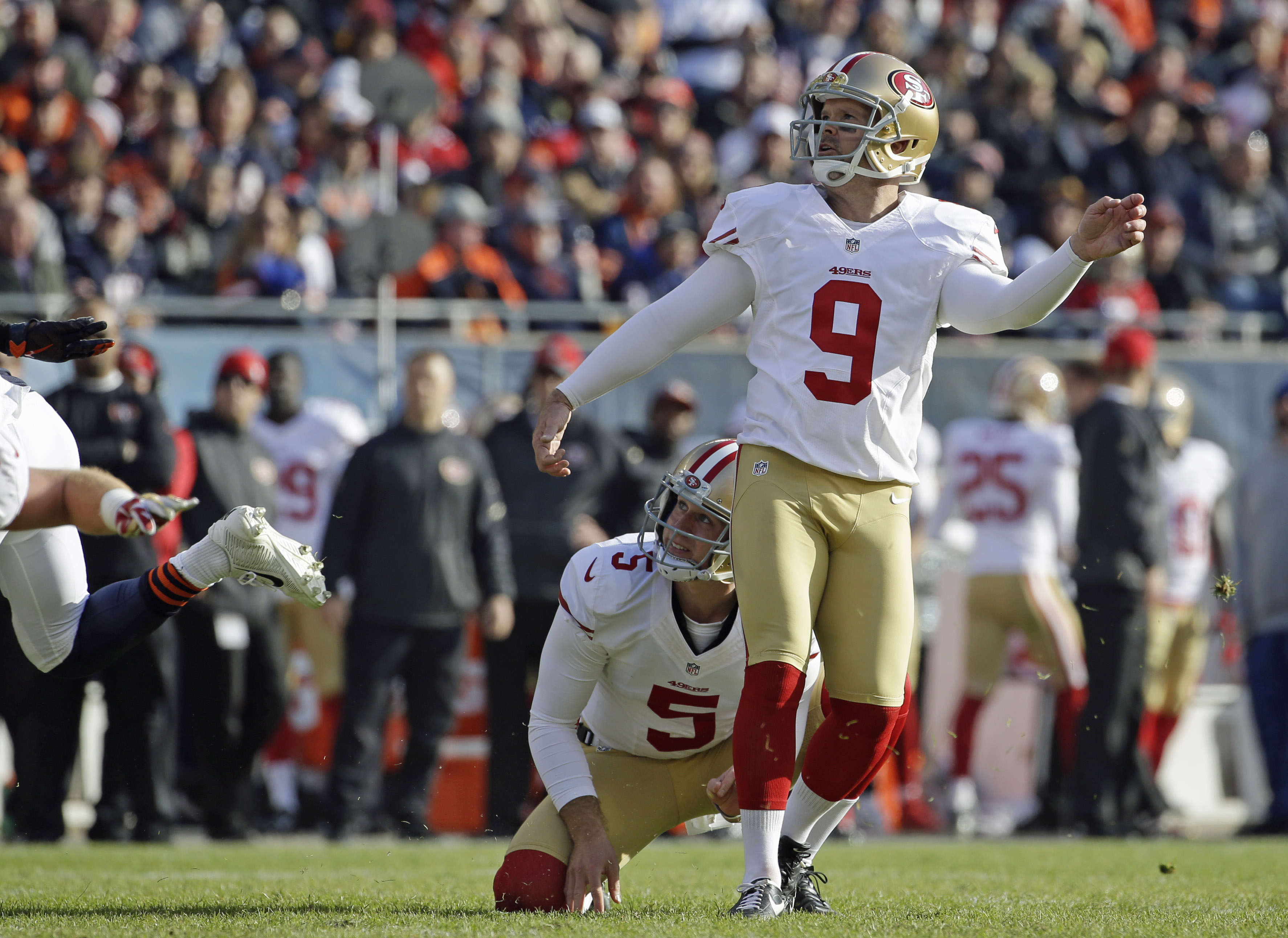 In this Dec. 6, 2015 photo, San Francisco 49ers' Phil Dawson (9) kicks an extra point during the first half of an NFL football game against the Chicago Bears, in Chicago. Dawson acknowledges there are a few more grays in his signature goatee these days, a