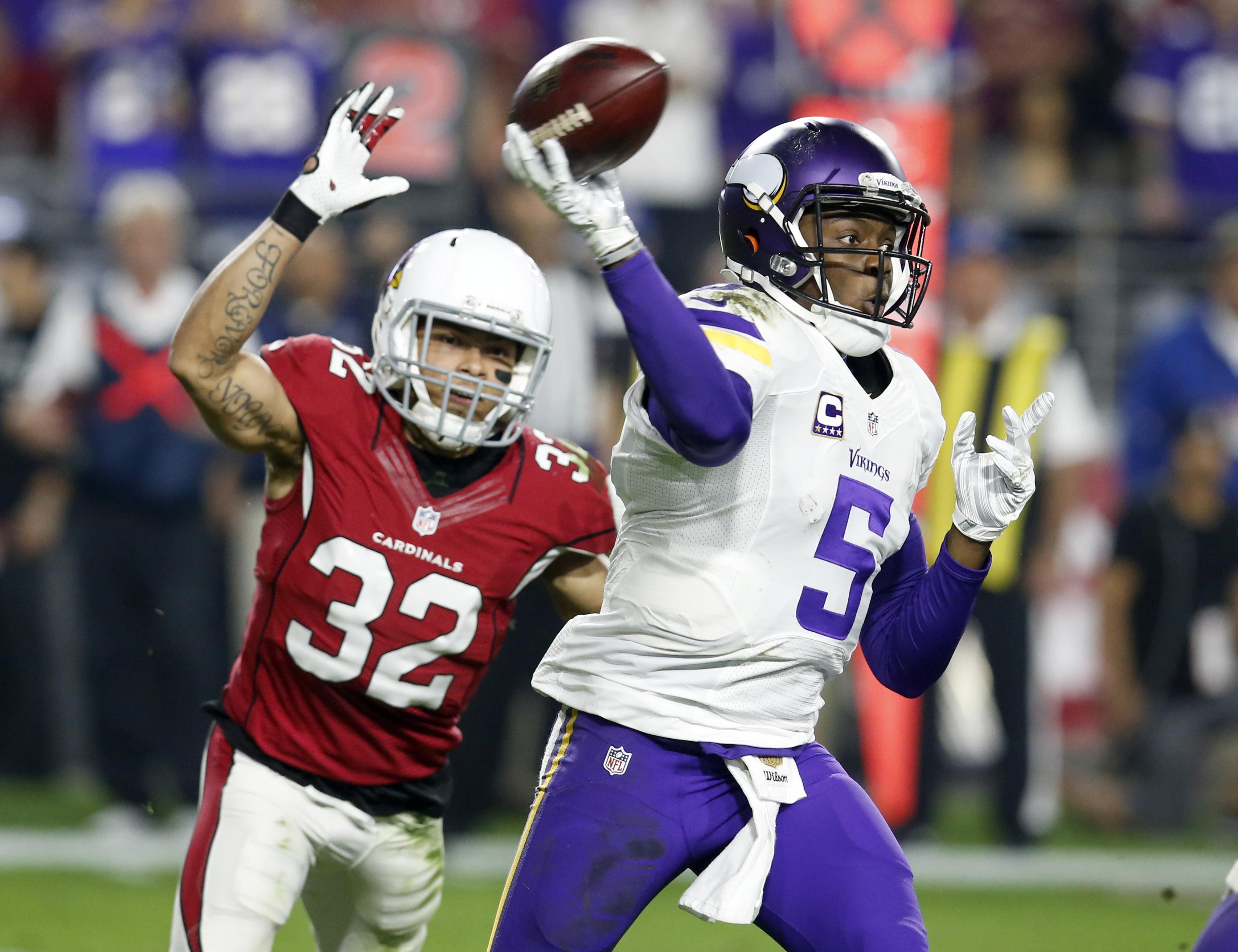 Minnesota Vikings quarterback Teddy Bridgewater (5) throws under pressure from Arizona Cardinals free safety Tyrann Mathieu (32) during the second half of an NFL football game, Thursday, Dec. 10, 2015, in Glendale, Ariz. (AP Photo/Rick Scuteri)