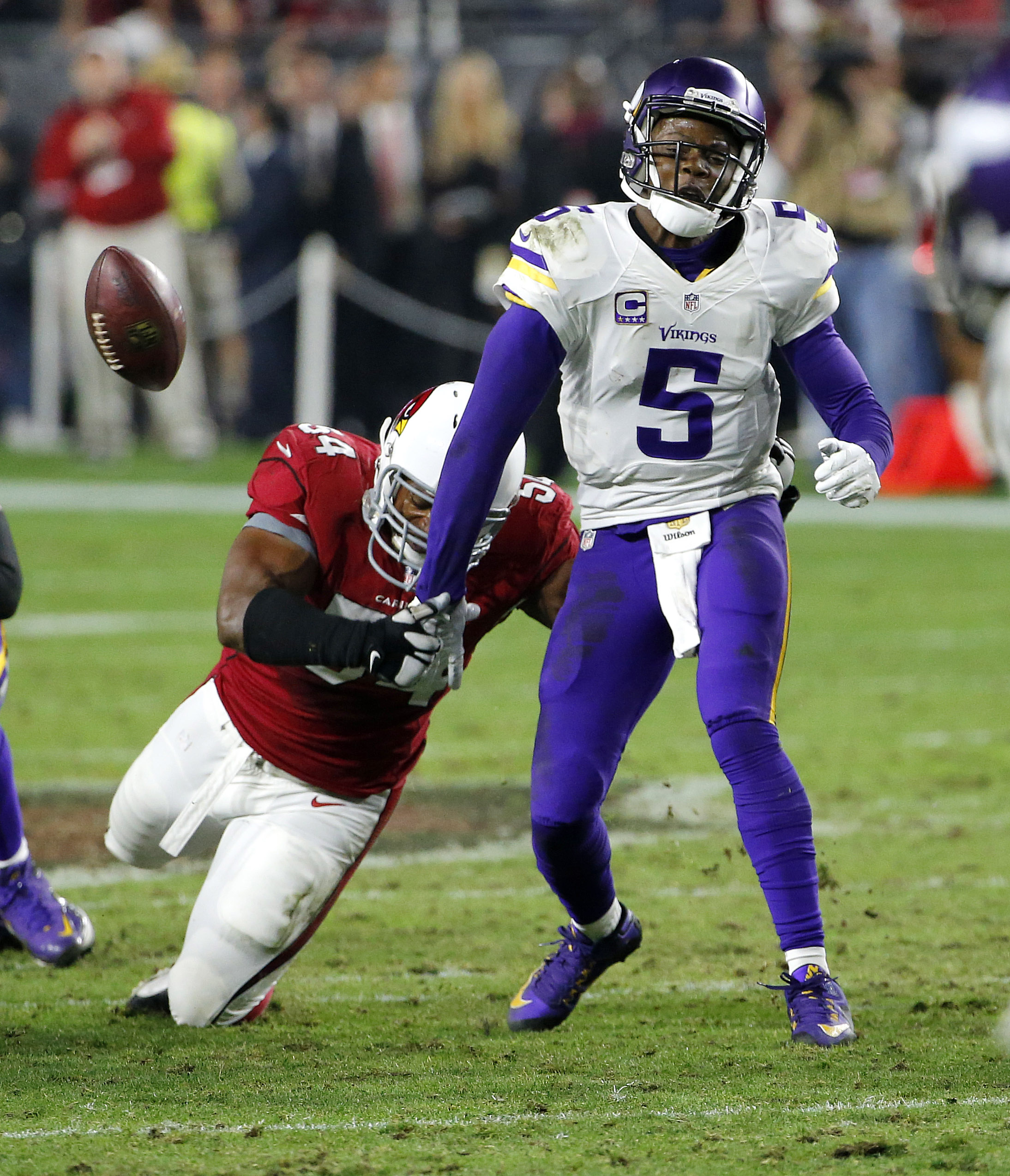 Arizona Cardinals inside linebacker Dwight Freeney (54) forces Minnesota Vikings quarterback Teddy Bridgewater (5) to fumble during the second half of an NFL football game, Thursday, Dec. 10, 2015, in Glendale, Ariz. The Cardinals recovered the ball to se