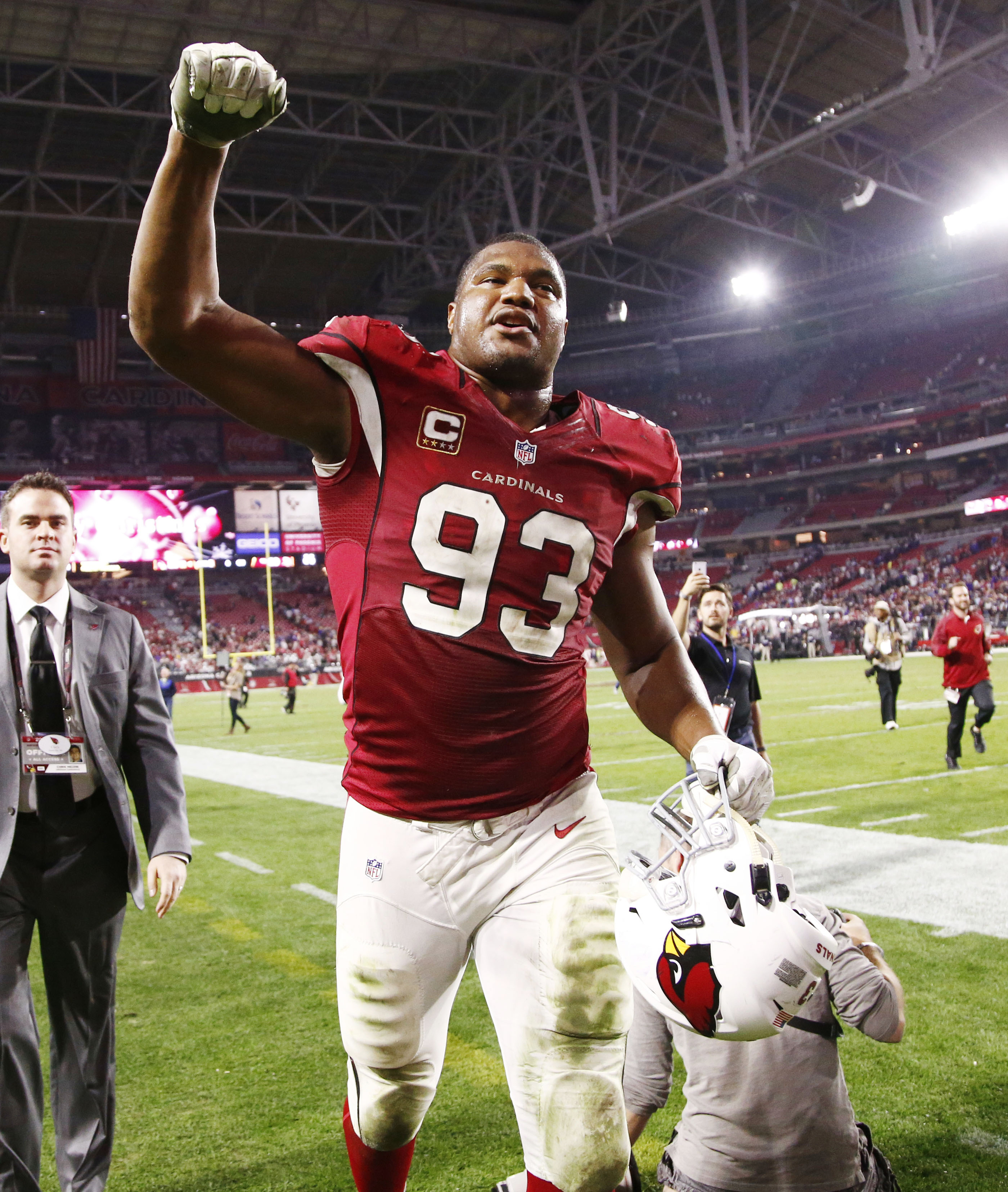 Arizona Cardinals Calais Campbell celebrates a victory over the Minnesota Vikings after an NFL football game Thursday, Dec. 10, 2015, in Glendale, Ariz. (Rob Schumacher/The Arizona Republic via AP)  MARICOPA COUNTY OUT; MAGS OUT; NO SALES; MANDATORY CREDI