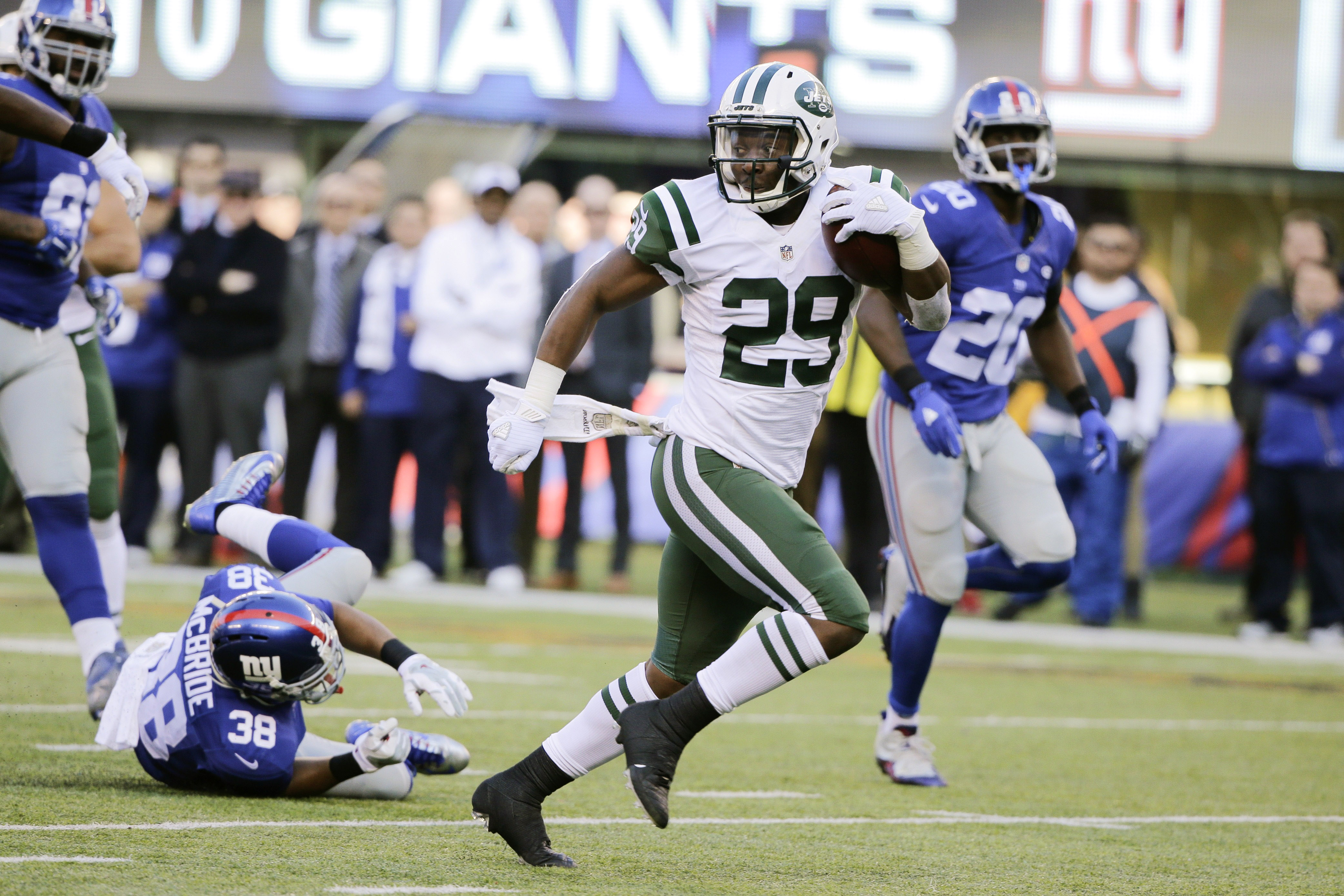 FILE - In this Dec. 6, 2015 file photo, New York Jets running back Bilal Powell (29) runs for a touchdown after catching a pass during the first half of an NFL football game against the New York Giants, in East Rutherford, N.J. Powell speaks barely above