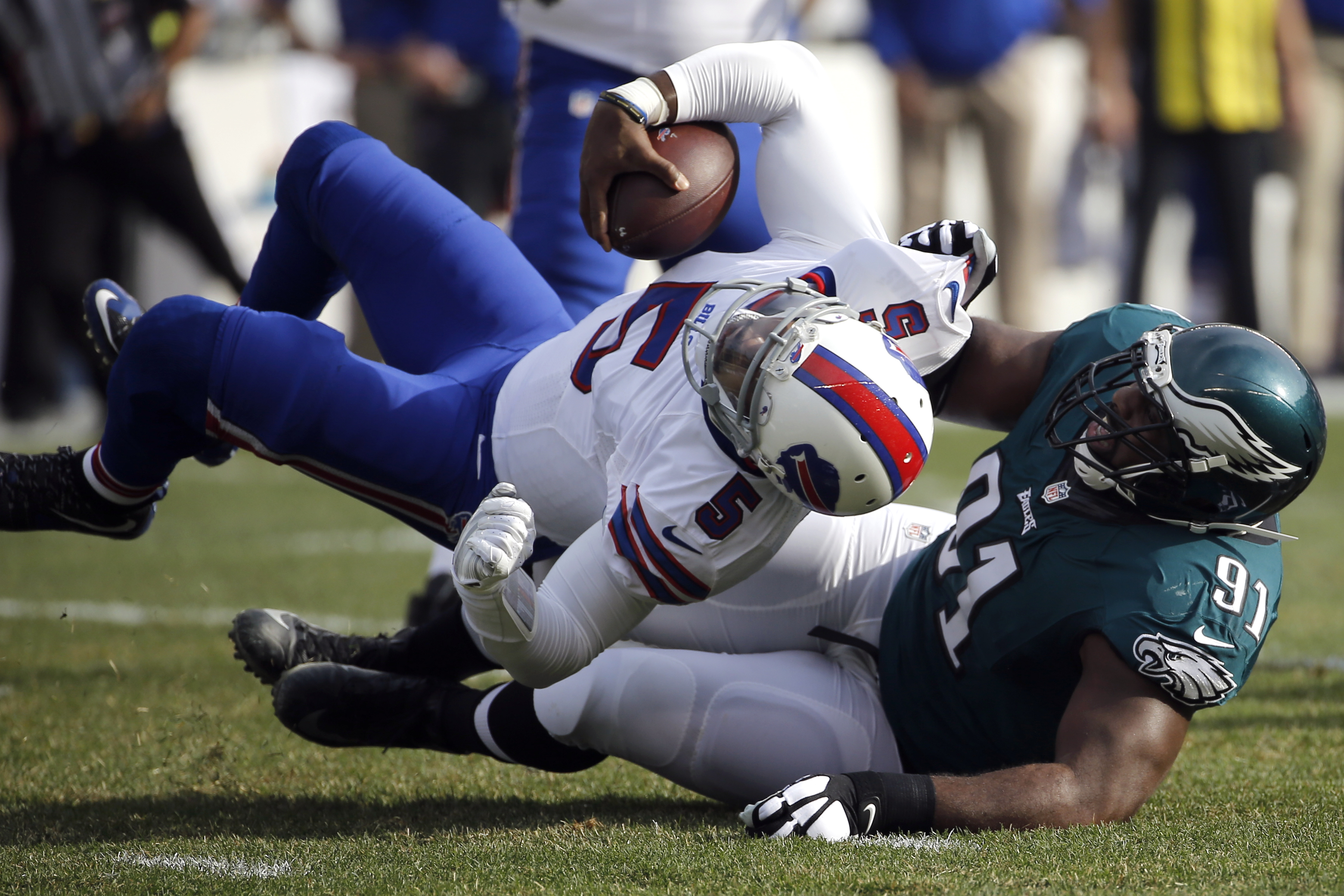 Buffalo Bills' Tyrod Taylor (5) is sacked by Philadelphia Eagles' Fletcher Cox (91) during the first half of an NFL football game, Sunday, Dec. 13, 2015, in Philadelphia. (AP Photo/Michael Perez)