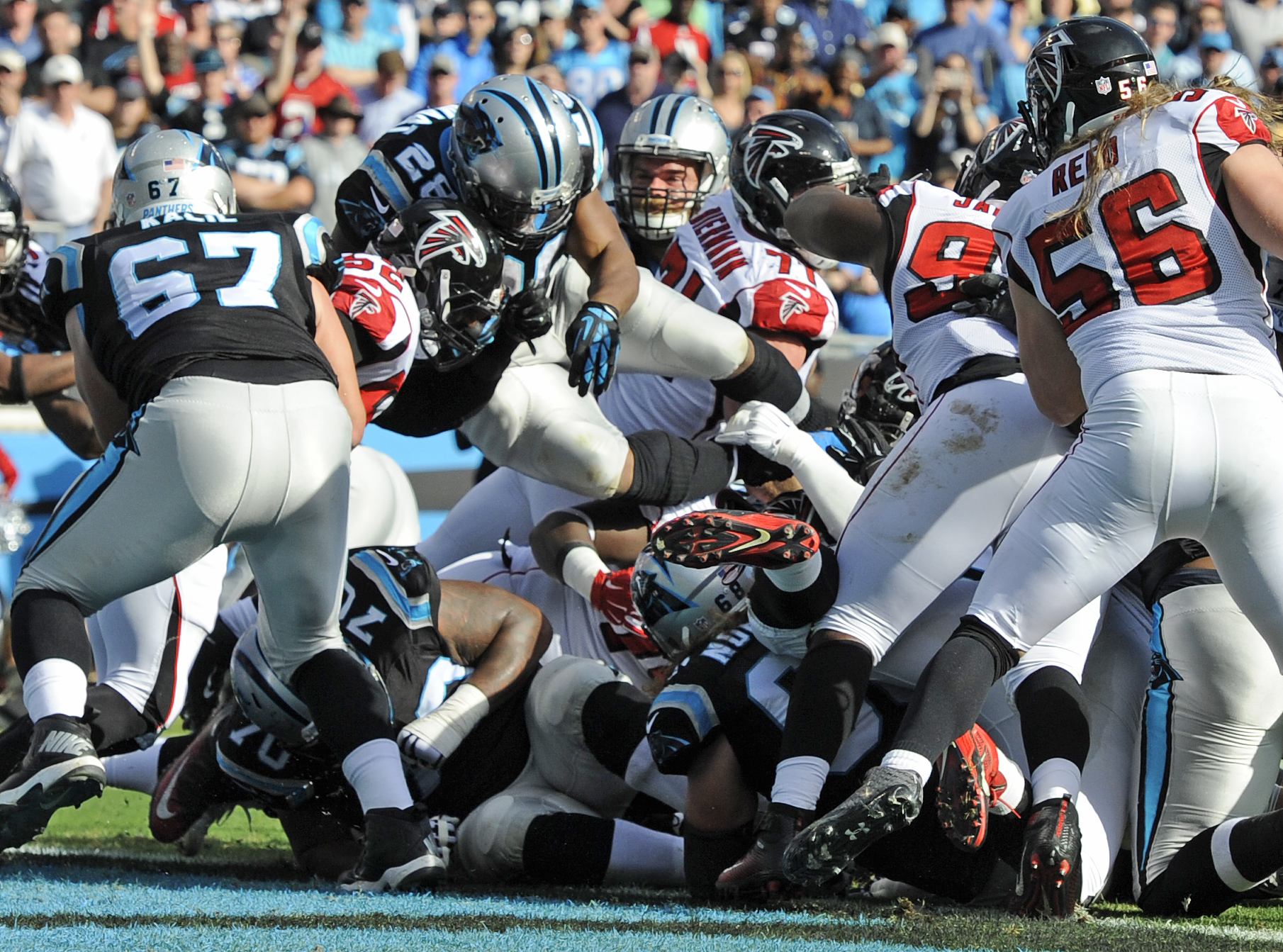 Carolina Panthers' Jonathan Stewart (28) dives into the end zone for a touchdown against the Atlanta Falcons in the first half of an NFL football game in Charlotte, N.C., Sunday, Dec. 13, 2015. (AP Photo/Mike McCarn)