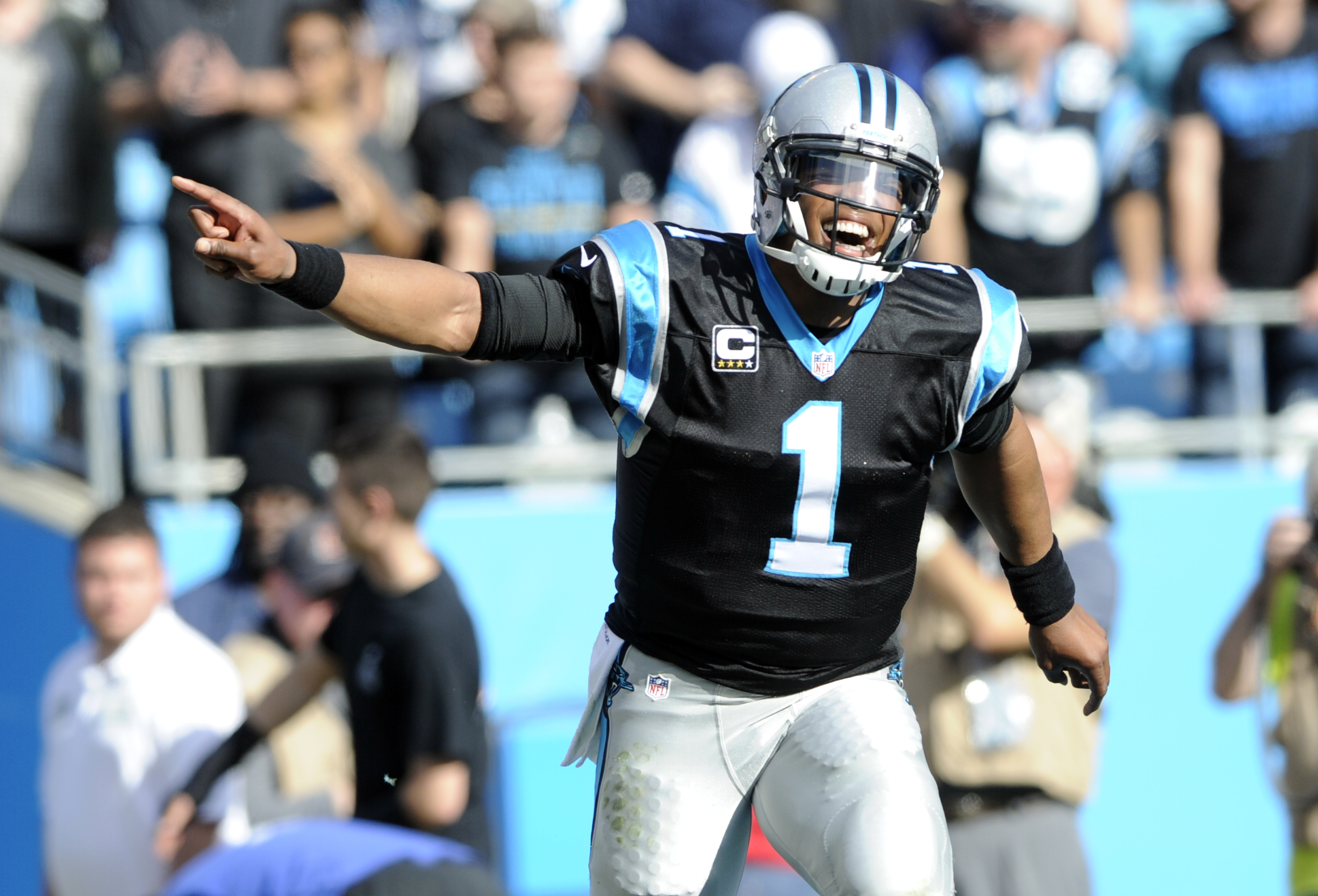 Carolina Panthers' Cam Newton (1) celebrates after a touchdown against the Atlanta Falcons in the first half of an NFL football game in Charlotte, N.C., Sunday, Dec. 13, 2015. (AP Photo/Mike McCarn)