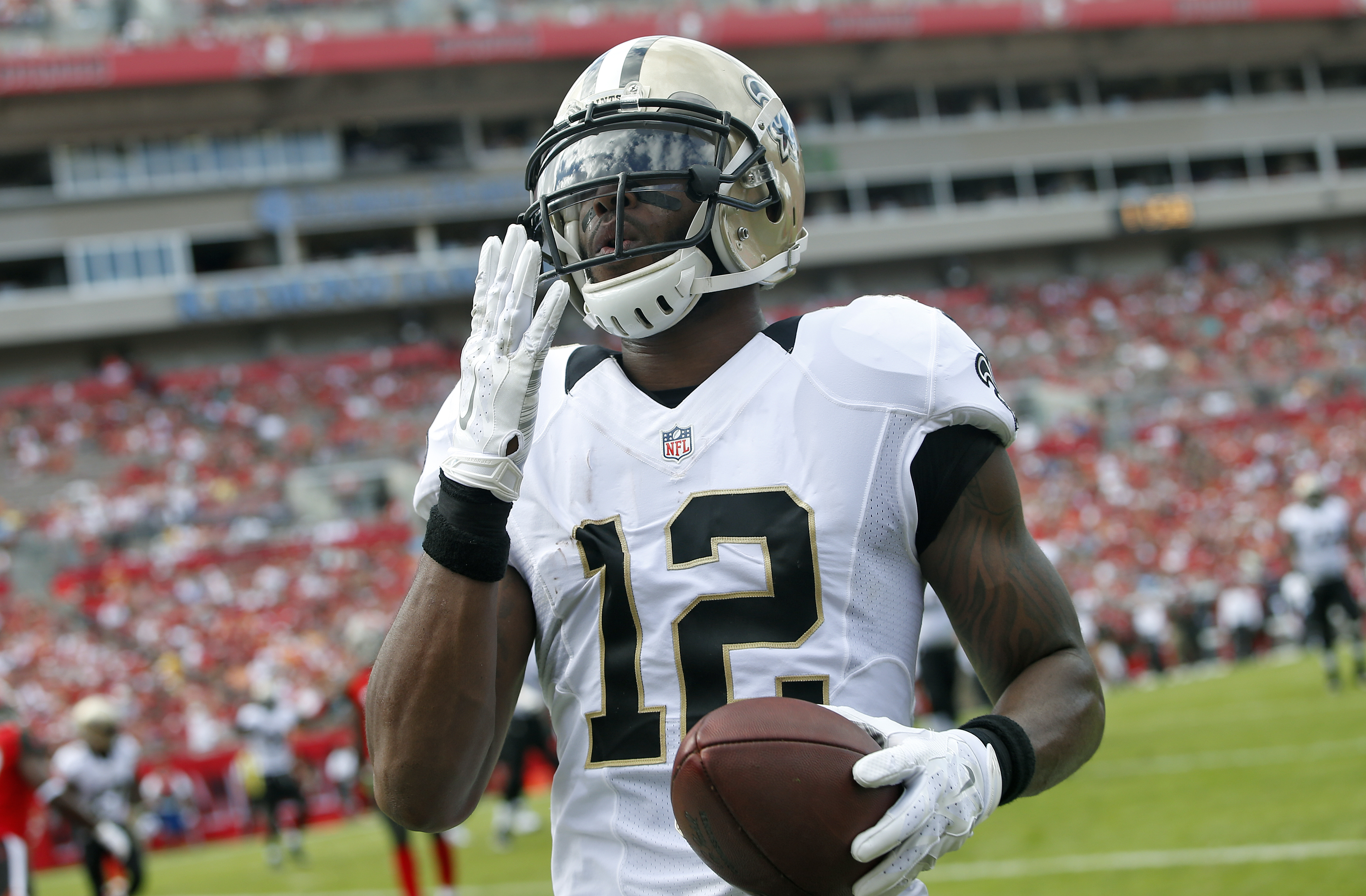 New Orleans Saints wide receiver Marques Colston (12) celebrates after his 1-yard touchdown reception during the second quarter of an NFL football game against the Tampa Bay Buccaneers Sunday, Dec. 13, 2015, in Tampa, Fla. (AP Photo/Brian Blanco)
