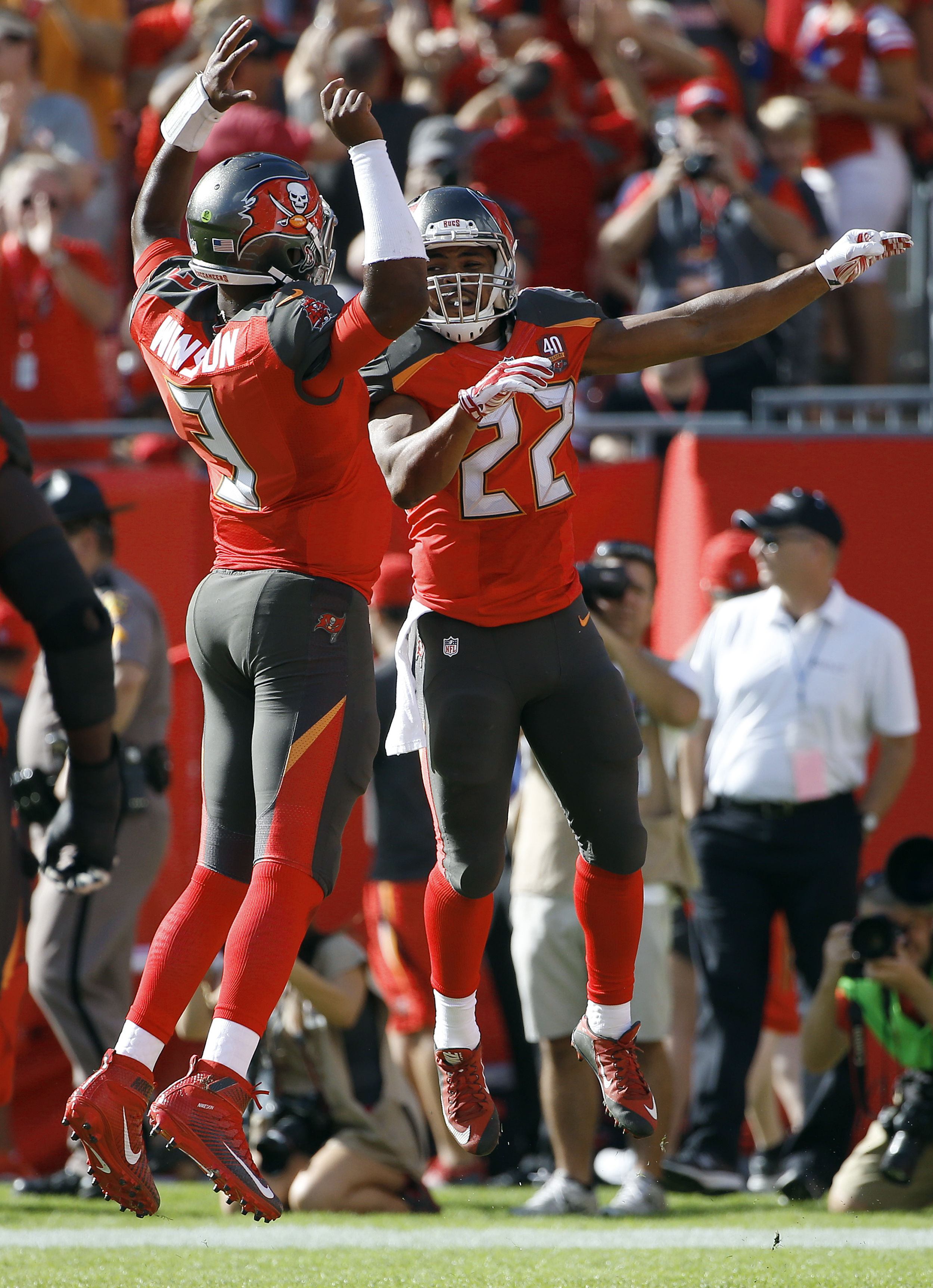 Tampa Bay Buccaneers running back Doug Martin (22) celebrates with quarterback Jameis Winston (3) after Martin's 14-yard touchdown run against the New Orleans Saints during the second quarter of an NFL football game Sunday, Dec. 13, 2015, in Tampa, Fla. (
