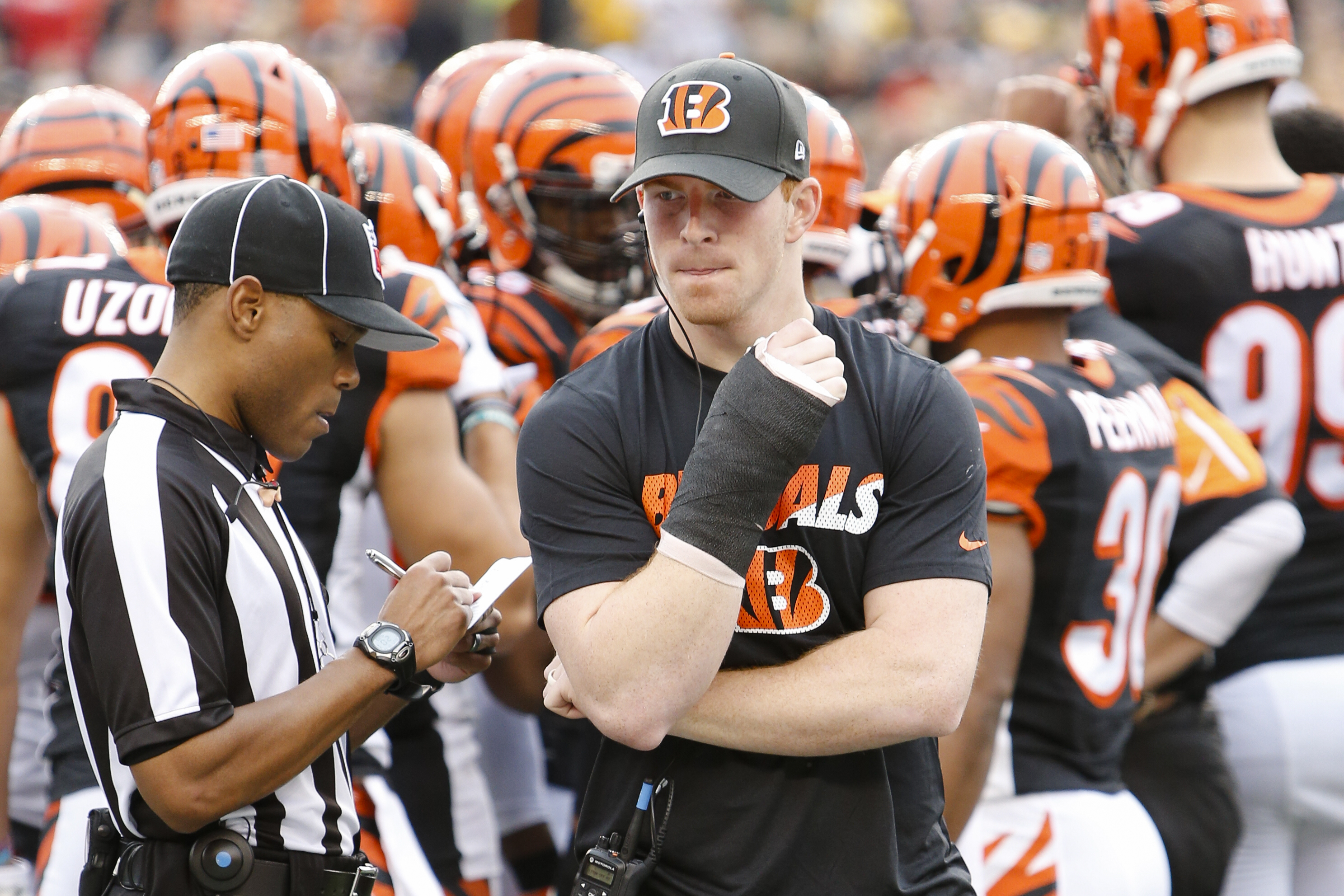 Cincinnati Bengals quarterback Andy Dalton walks the sideline with a cast on his throwing hand in the first half of an NFL football game against the Pittsburgh Steelers, Sunday, Dec. 13, 2015, in Cincinnati. (AP Photo/Frank Victores)