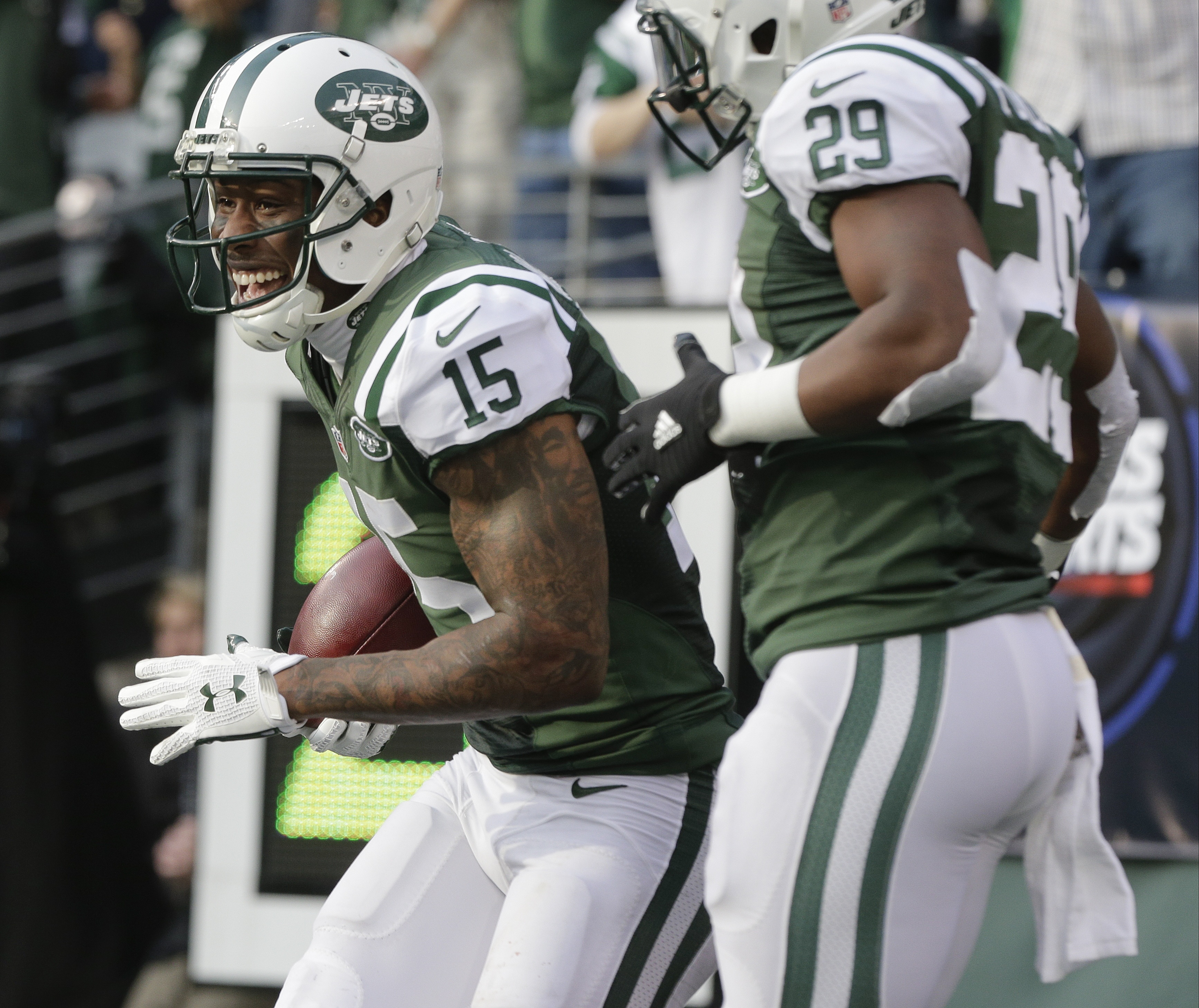New York Jets wide receiver Brandon Marshall (15) celebrates with teammate Bilal Powell (29) after scoring a touchdown during the first half of an NFL football game against the Tennessee Titans Sunday, Dec. 13, 2015, in East Rutherford, N.J.  (AP Photo/Pe