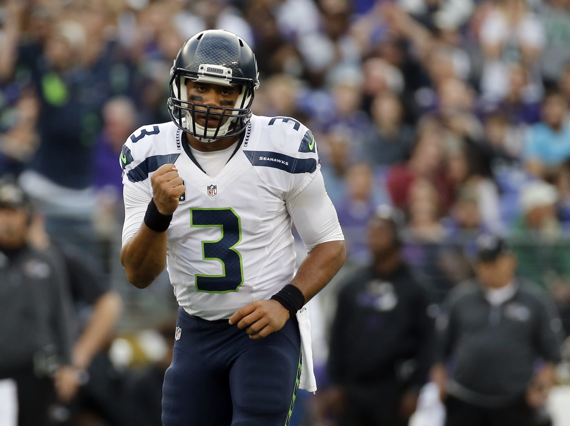 Seattle Seahawks quarterback Russell Wilson (3) celebrates a touchdown pass to Seahawks wide receiver Doug Baldwin during the second half an NFL football game against the Baltimore Ravens, Sunday, Dec. 13, 2015, in Baltimore. (AP Photo/Patrick Semansky)