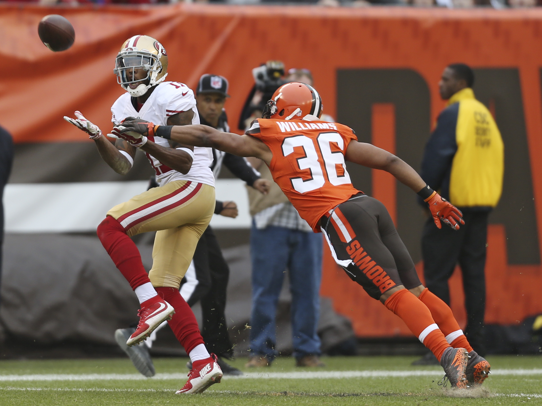 Cleveland Browns wide receiver Travis Benjamin (11) catches a pass as San Francisco 49ers cornerback Dontae Johnson (36) defends during the second half of an NFL football game, Sunday, Dec. 13, 2015, in Cleveland. There was a penalty on the play. (AP Phot