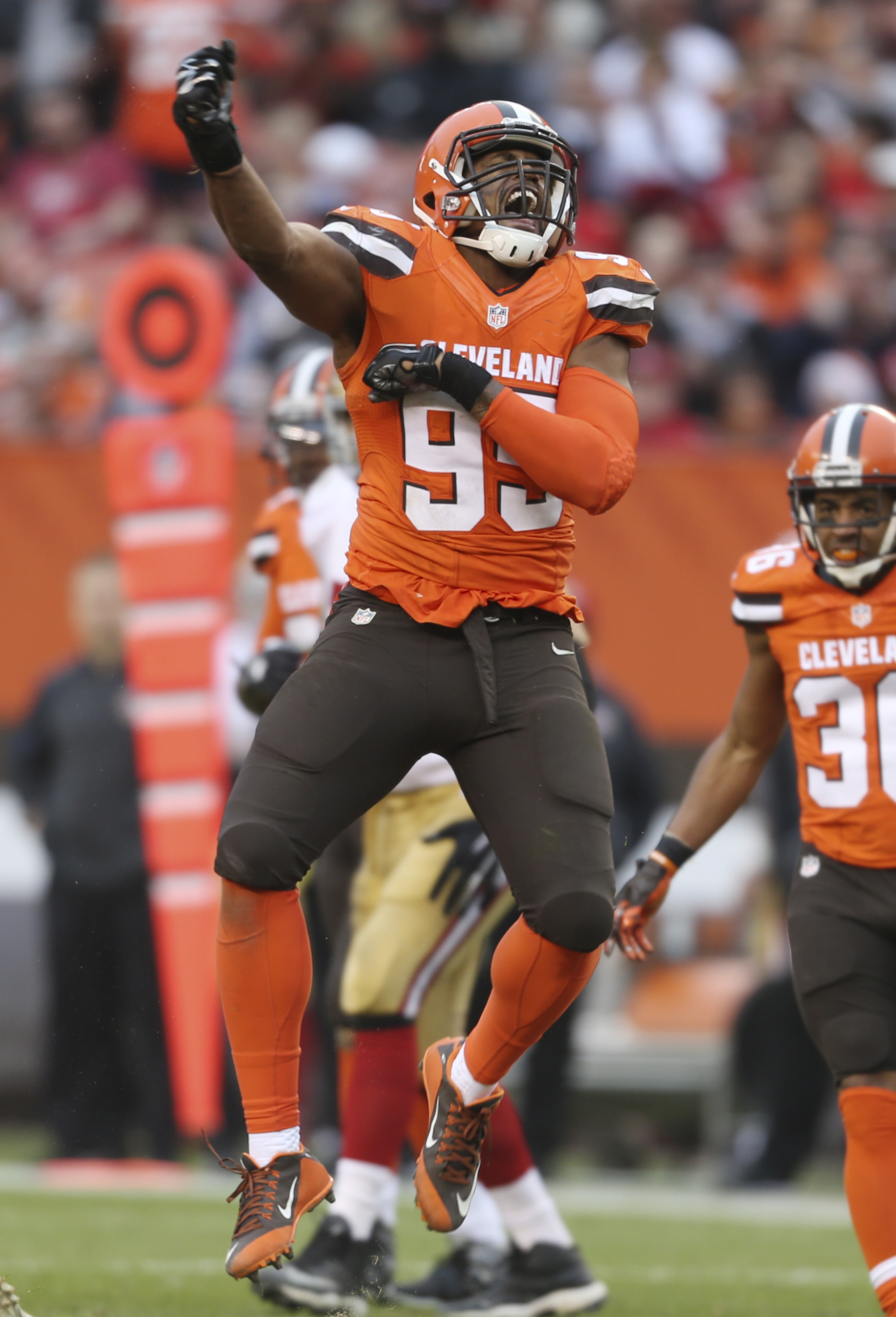 Cleveland Browns defensive end Armonty Bryant (95) celebrates after sacking San Francisco 49ers quarterback Blaine Gabbert (2) during the second half of an NFL football game, Sunday, Dec. 13, 2015, in Cleveland. (AP Photo/Ron Schwane)