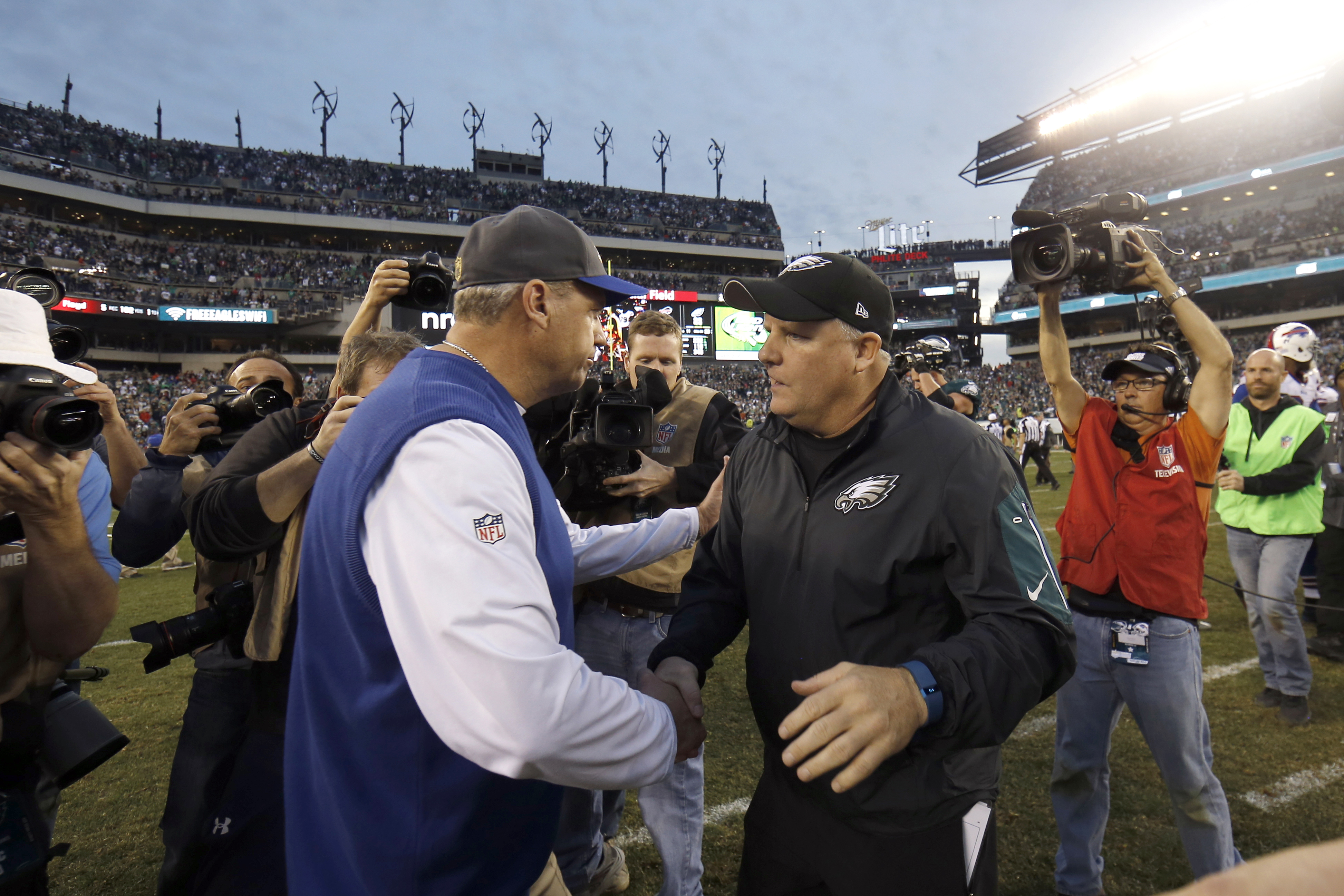 Philadelphia Eagles' Chip Kelly, right, and Buffalo Bills' Rex Ryan, left, meet after an NFL football game, Sunday, Dec. 13, 2015, in Philadelphia. Philadelphia won 23-20. (AP Photo/Michael Perez)