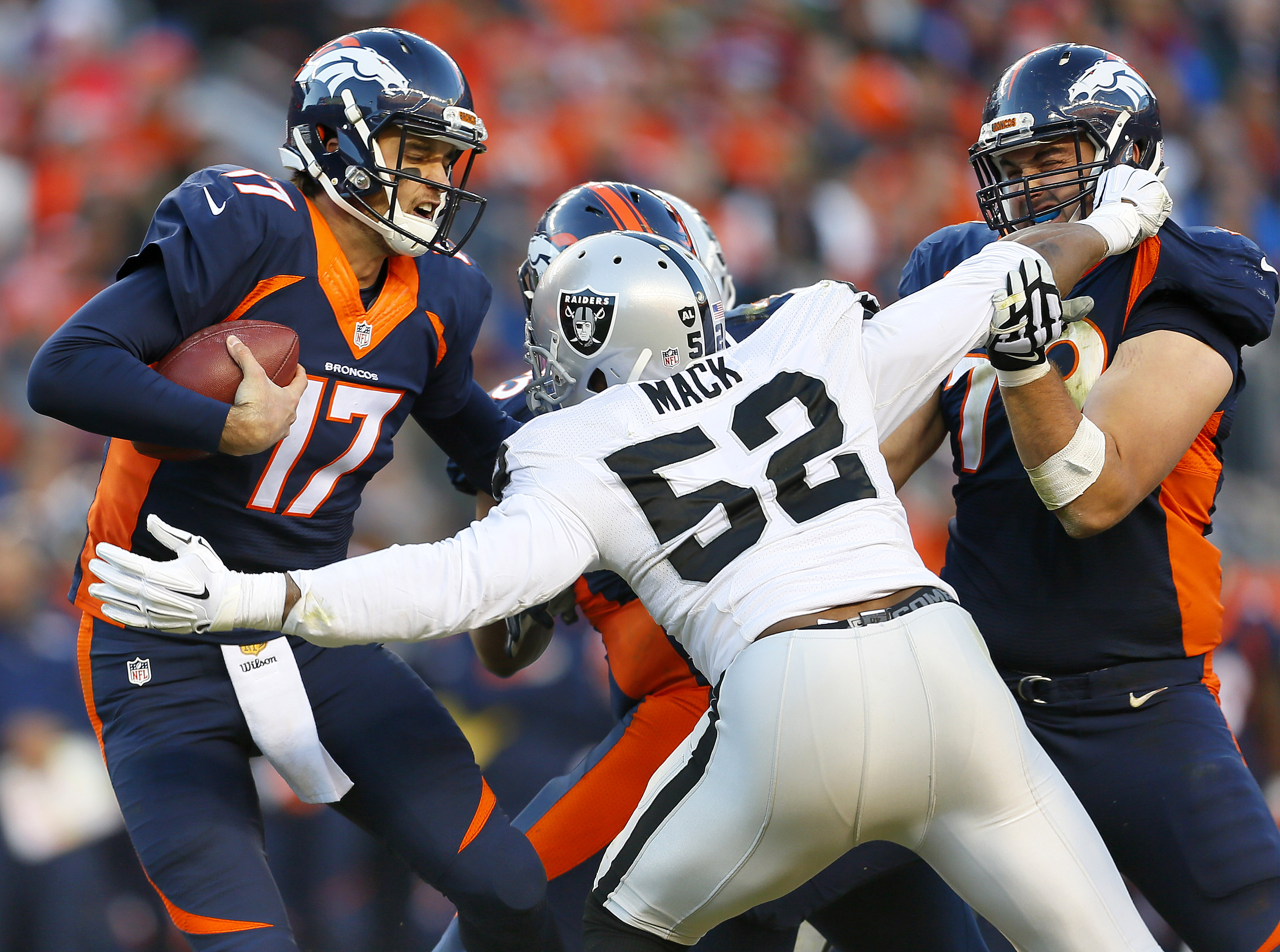 Denver Broncos quarterback Brock Osweiler (17) is sacked by Oakland Raiders defensive end Khalil Mack (52) during the second half of an NFL football game, Sunday, Dec. 13, 2015, in Denver. (AP Photo/Joe Mahoney)