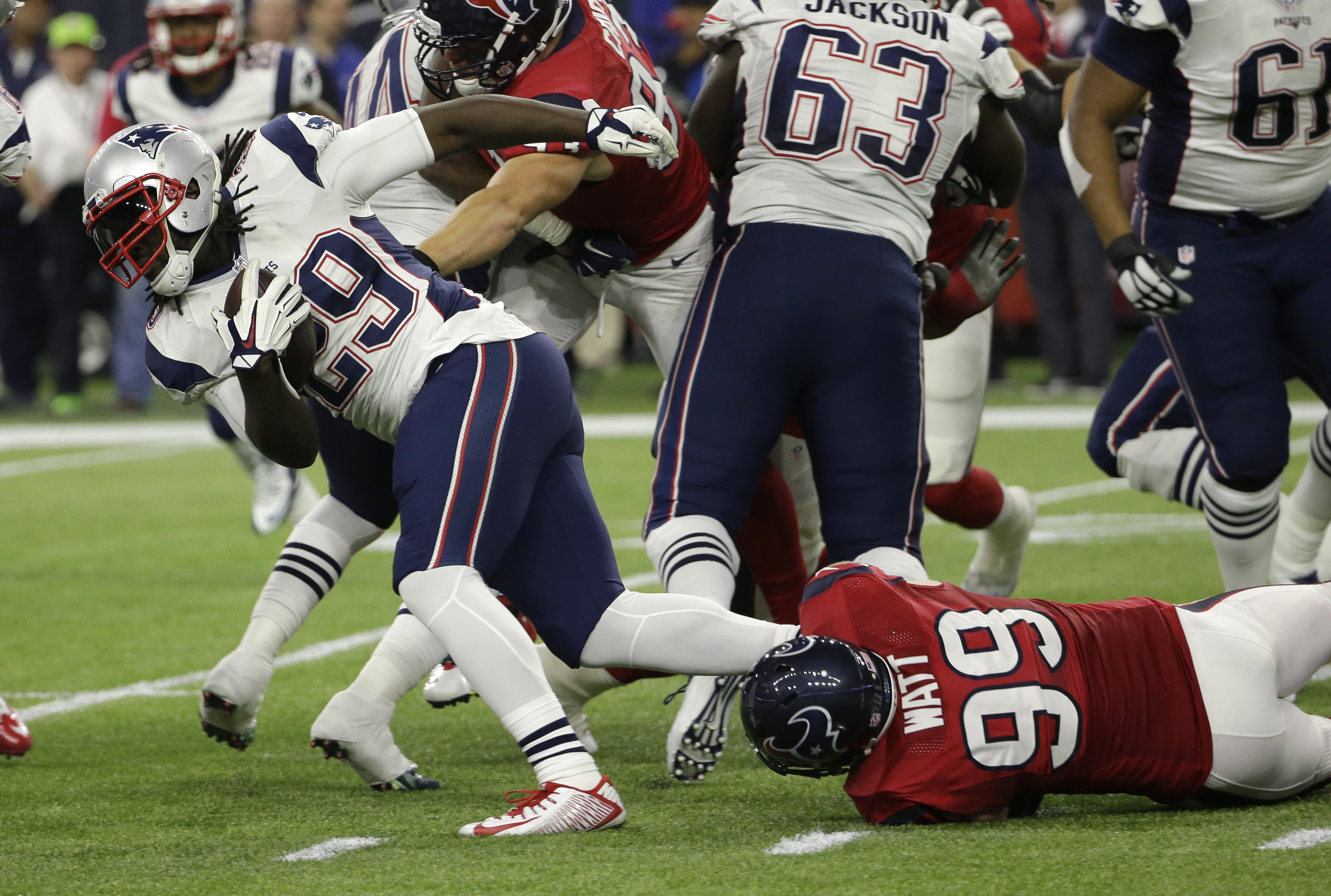New England Patriots running back LeGarrette Blount (29) is stopped by Houston Texans defensive end J.J. Watt (99) during the first half of an NFL football game, Sunday, Dec. 13, 2015, in Houston. (AP Photo/David J. Phillip)
