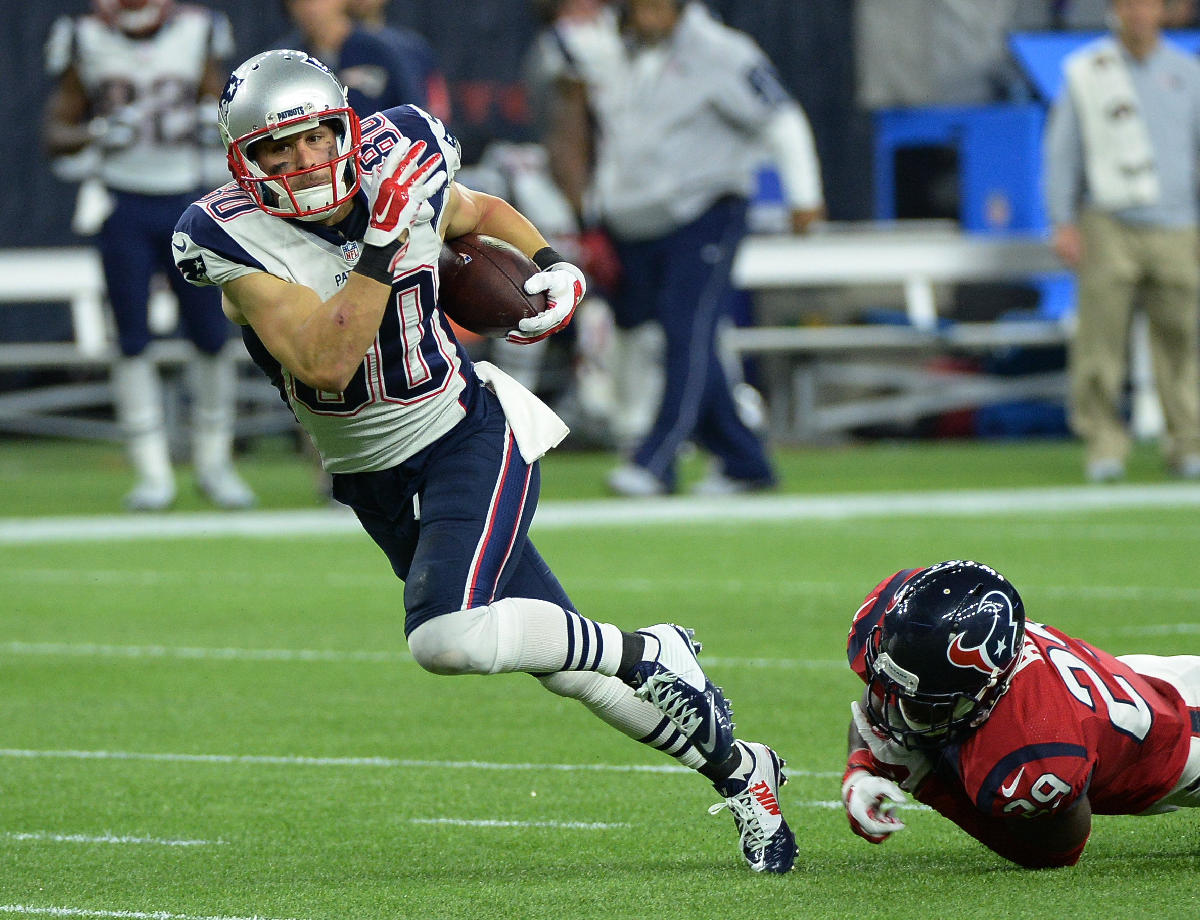 New England Patriots wide receiver Danny Amendola (80) escapes the grasp of Houston Texans strong safety Andre Hal (29) after making a catch during the first half of an NFL football game Sunday,  Dec. 13, 2015, in Houston. (AP Photo/George Bridges)