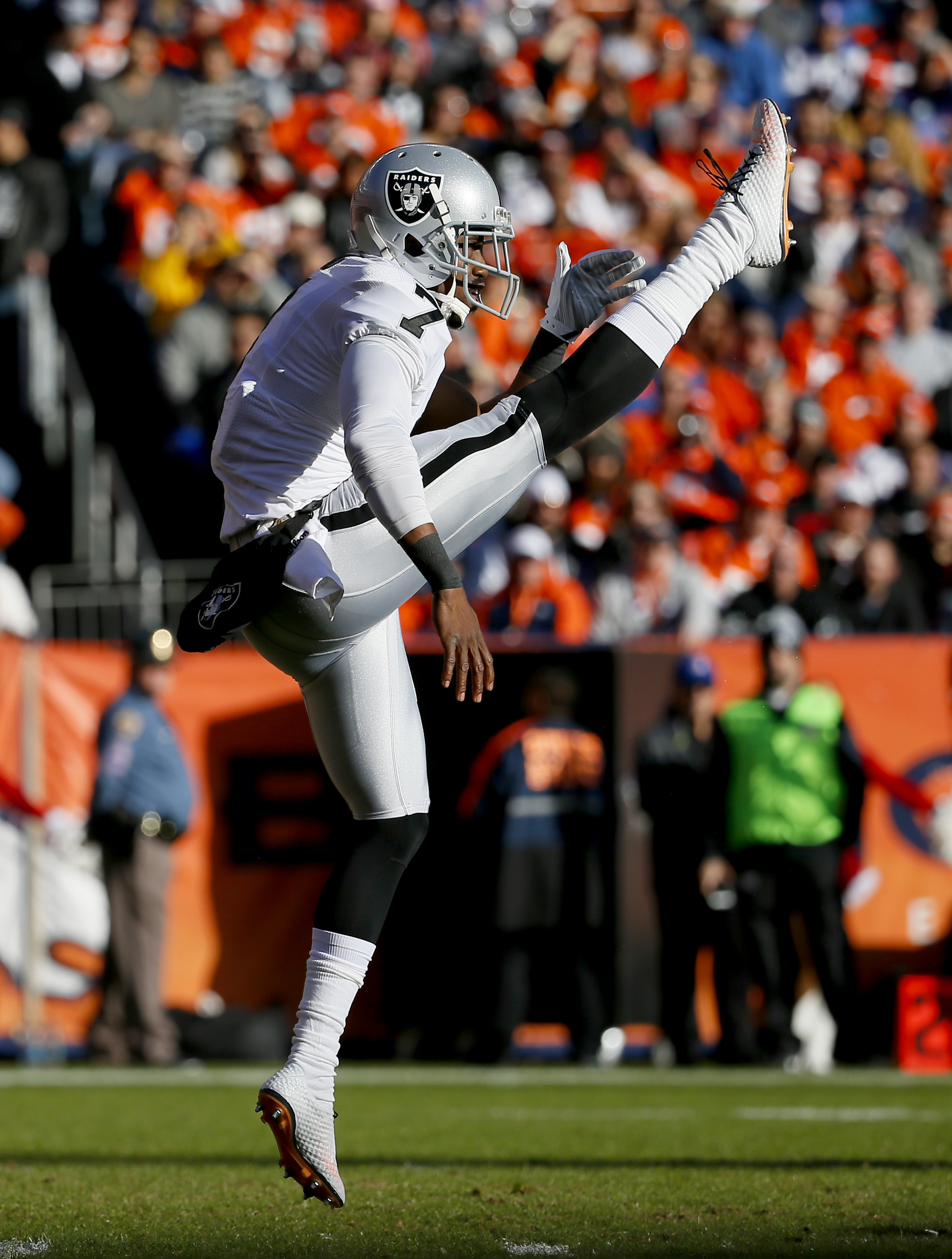 FILE - In this Dec. 13, 2015, file photo, Oakland Raiders punter Marquette King (7) punts against the Denver Broncos during the first half of an NFL football game, in Denver. With five punts inside the 20, Marquette King was an unsung hero for the Raiders