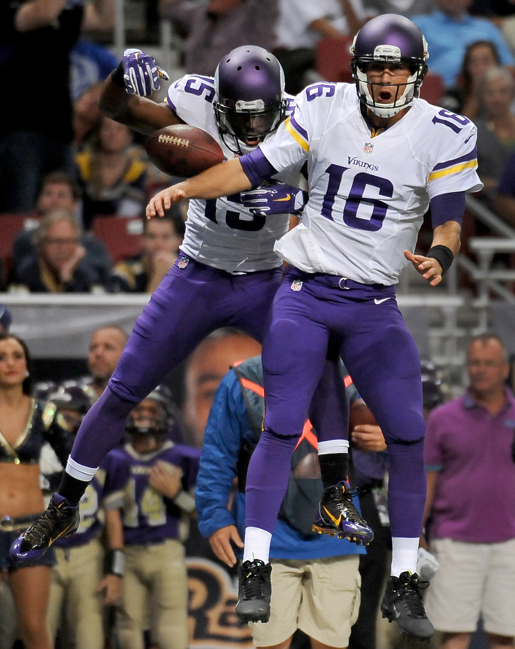 FILE - In this Sept. 7, 2014, file photo, Minnesota Vikings quarterback Matt Cassel, right, celebrates after throwing an 8-yard touchdown pass to wide receiver Greg Jennings, left, during the second quarter an NFL football game against the St. Louis Rams