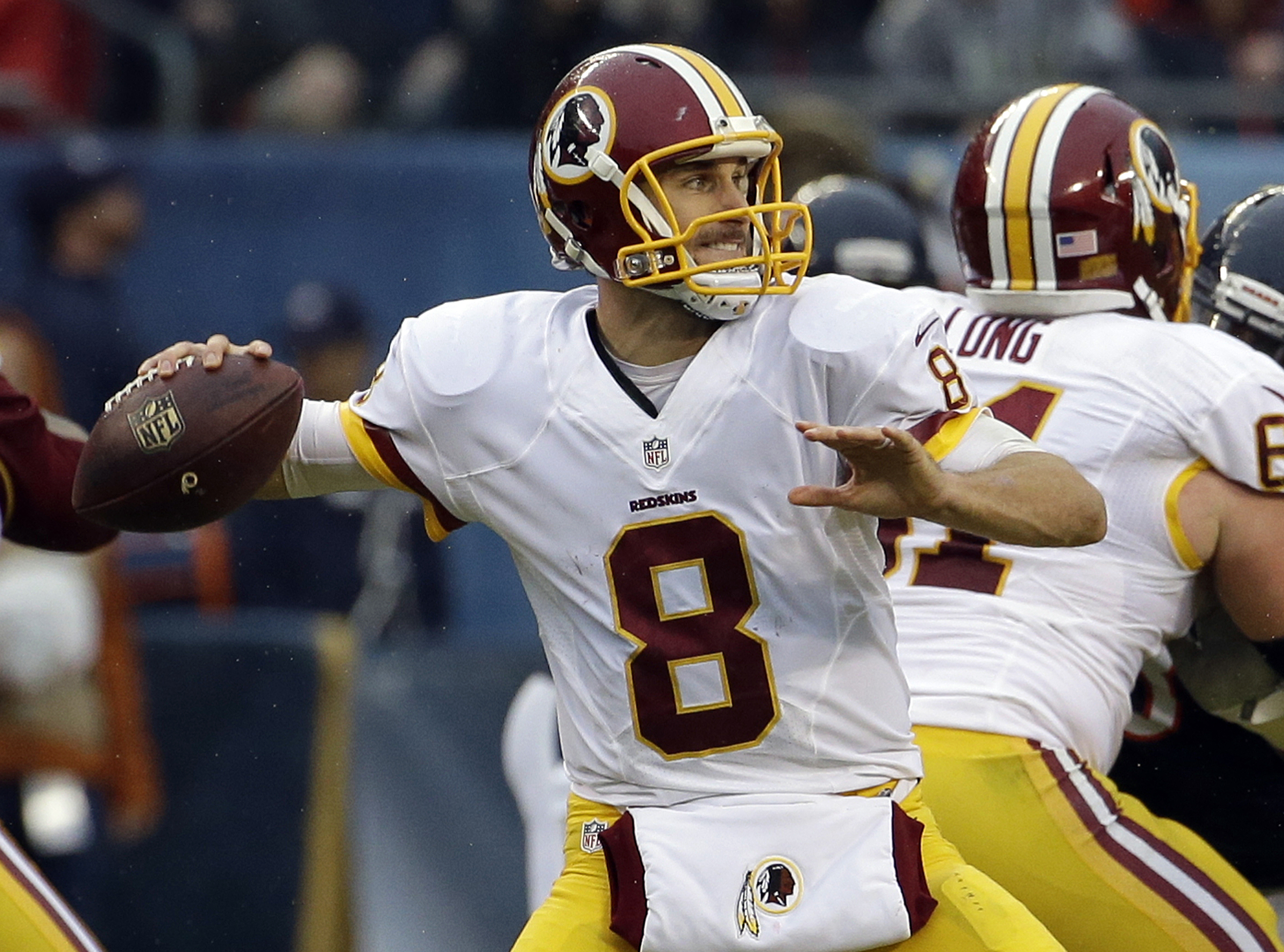 FILE - In this Dec. 13, 2015 file photo, Washington Redskins quarterback Kirk Cousins (8) throws during the second half of an NFL football game against the Chicago Bears in Chicago. Publicly, anyway, the Washington Redskins have not made clear whether the