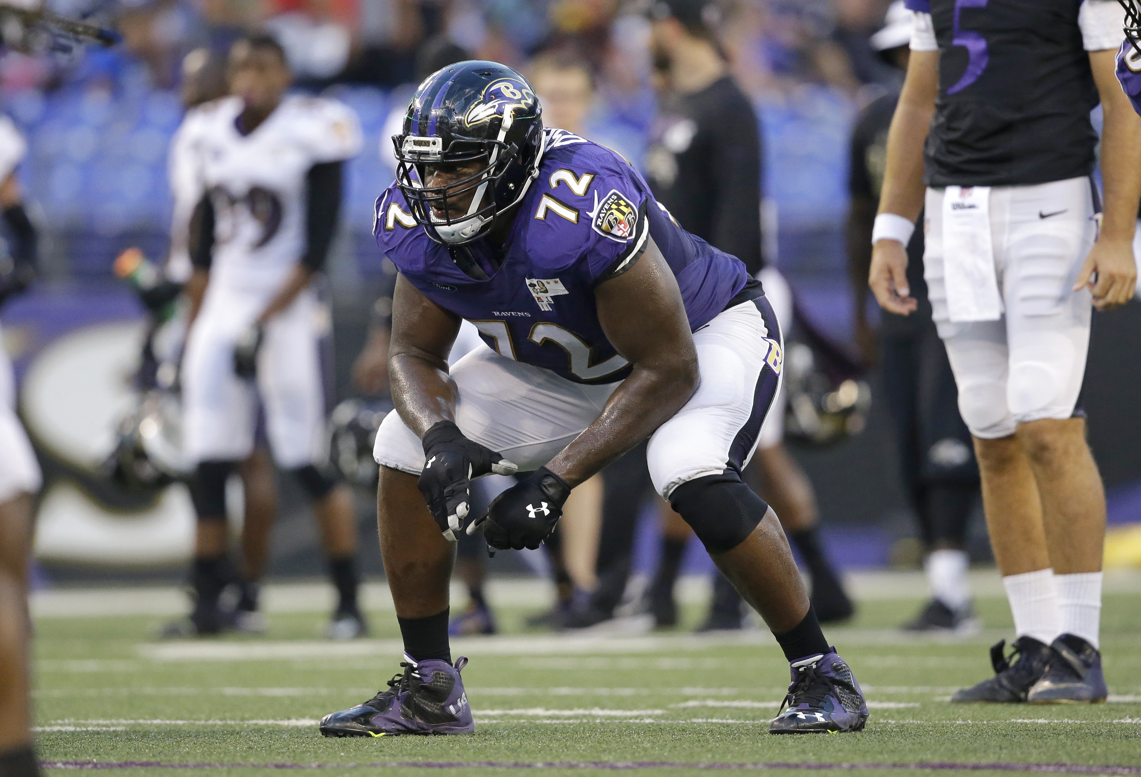 FILE - In this Aug. 3, 2015, file photo, Baltimore Ravens guard Kelechi Osemele lines up for a play during NFL football training camp, in Baltimore. If Kelechi Osemele can excel at left tackle in place of the injured Eugene Monroe over the next three week