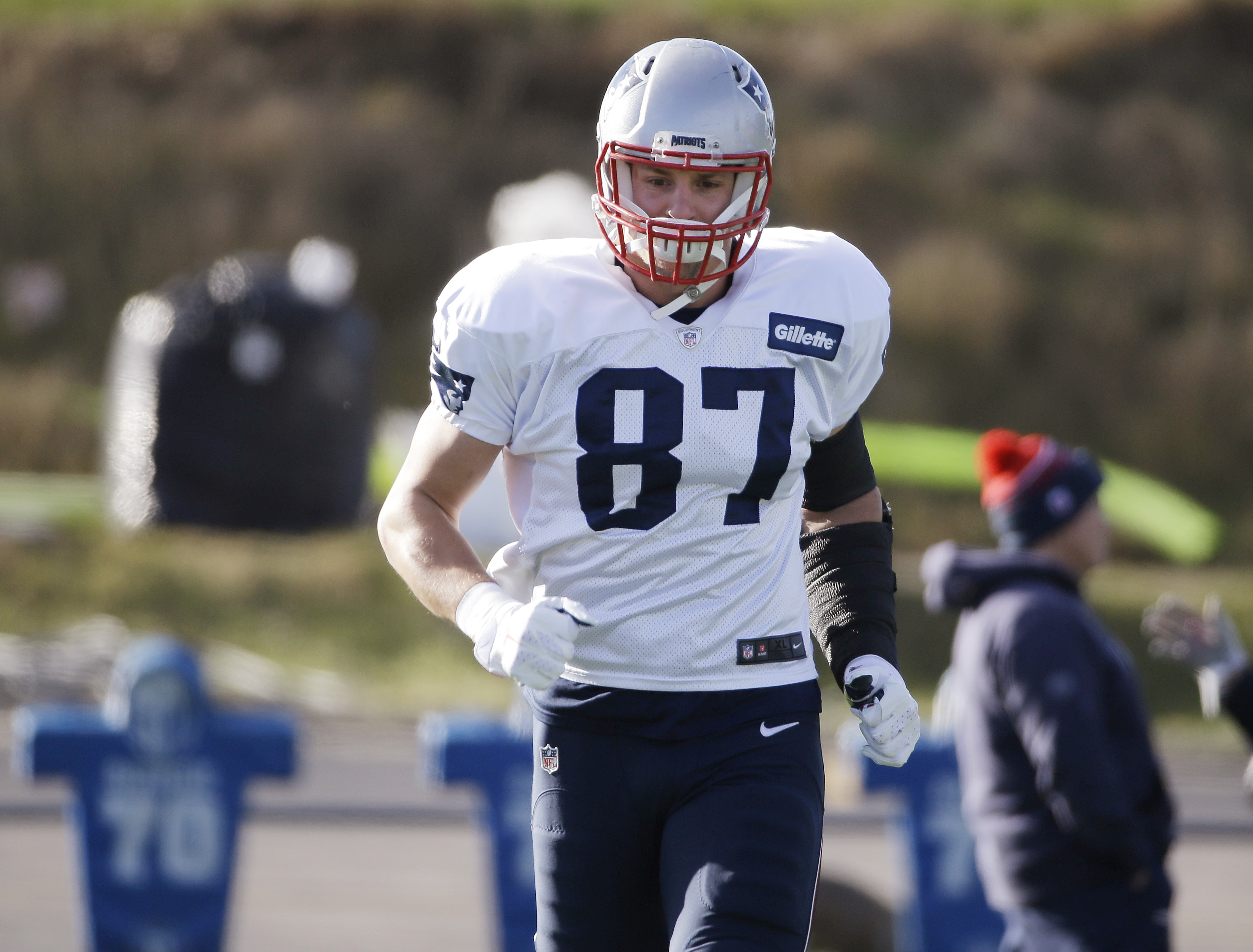 New England Patriots tight end Rob Gronkowski (87) runs during practice at the NFL football team's facility Wednesday, Dec. 16, 2015, in Foxborough, Mass. (AP Photo/Stephan Savoia)
