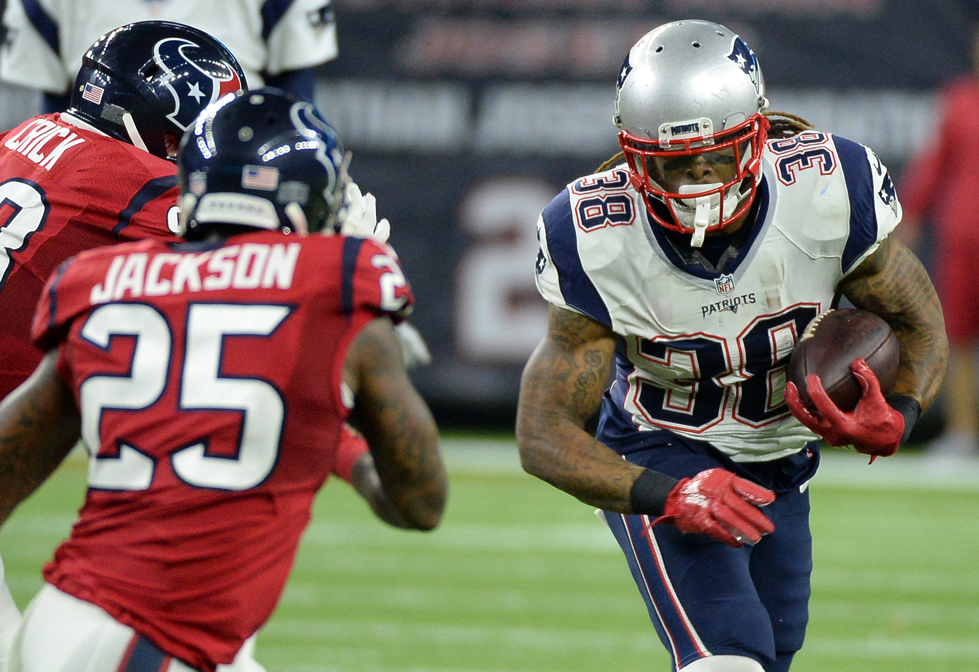 FILE - In this Sunday, Dec. 13, 2015, file photo, New England Patriots running back Brandon Bolden carries the ball outside as Houston Texans' Jared Crick (93) and Kareem Jackson (25) pursue during the first half of an NFL football game in Houston. As the