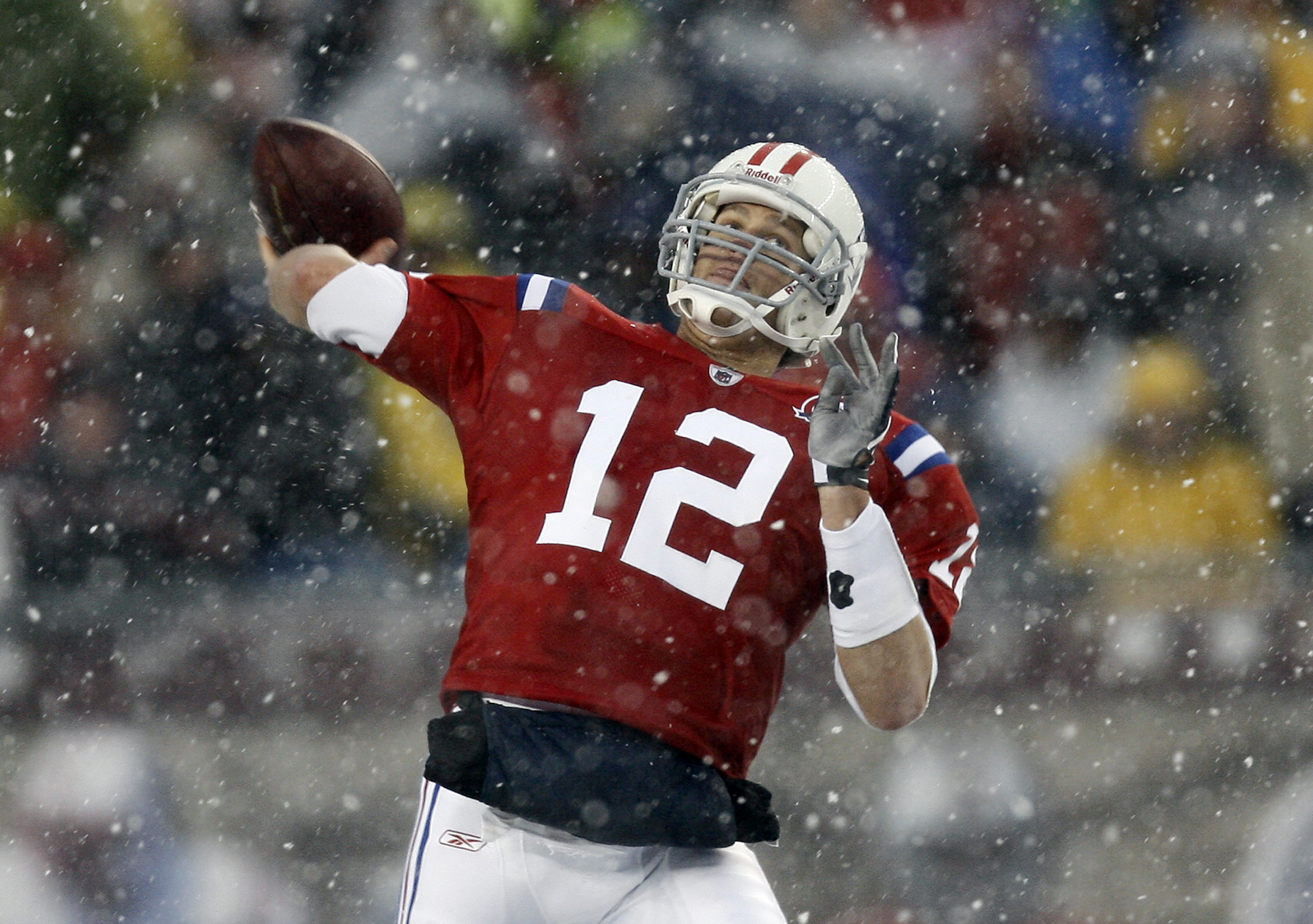 FILE - In this Oct. 18, 2009, file photo, New England Patriots quarterback Tom Brady throws a pass during the second quarter of an NFL football game against the Tennessee Titans at Gillette Stadium in Foxborough, Mass. The Patriots play the Titans on Sund
