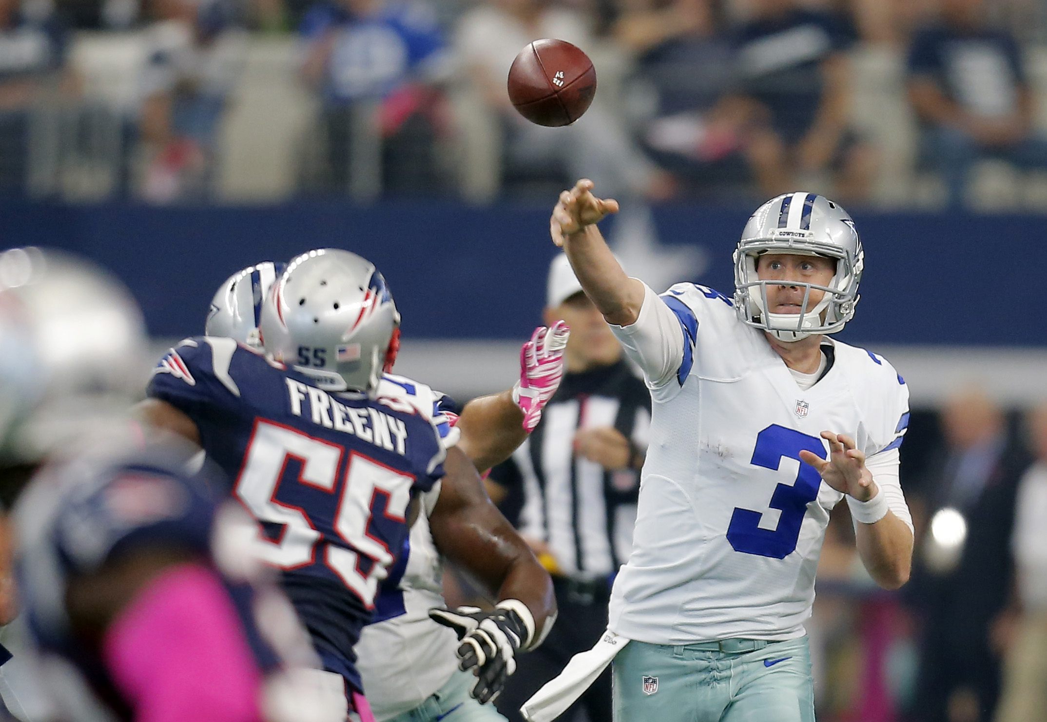 FILE - In this Oct. 11, 2015, file photo, Dallas Cowboys' Brandon Weeden (3) throws against the New England Patriots during the first quarter of an NFL football game,  in Arlington, Texas. The list of key players injured this season would make even some c