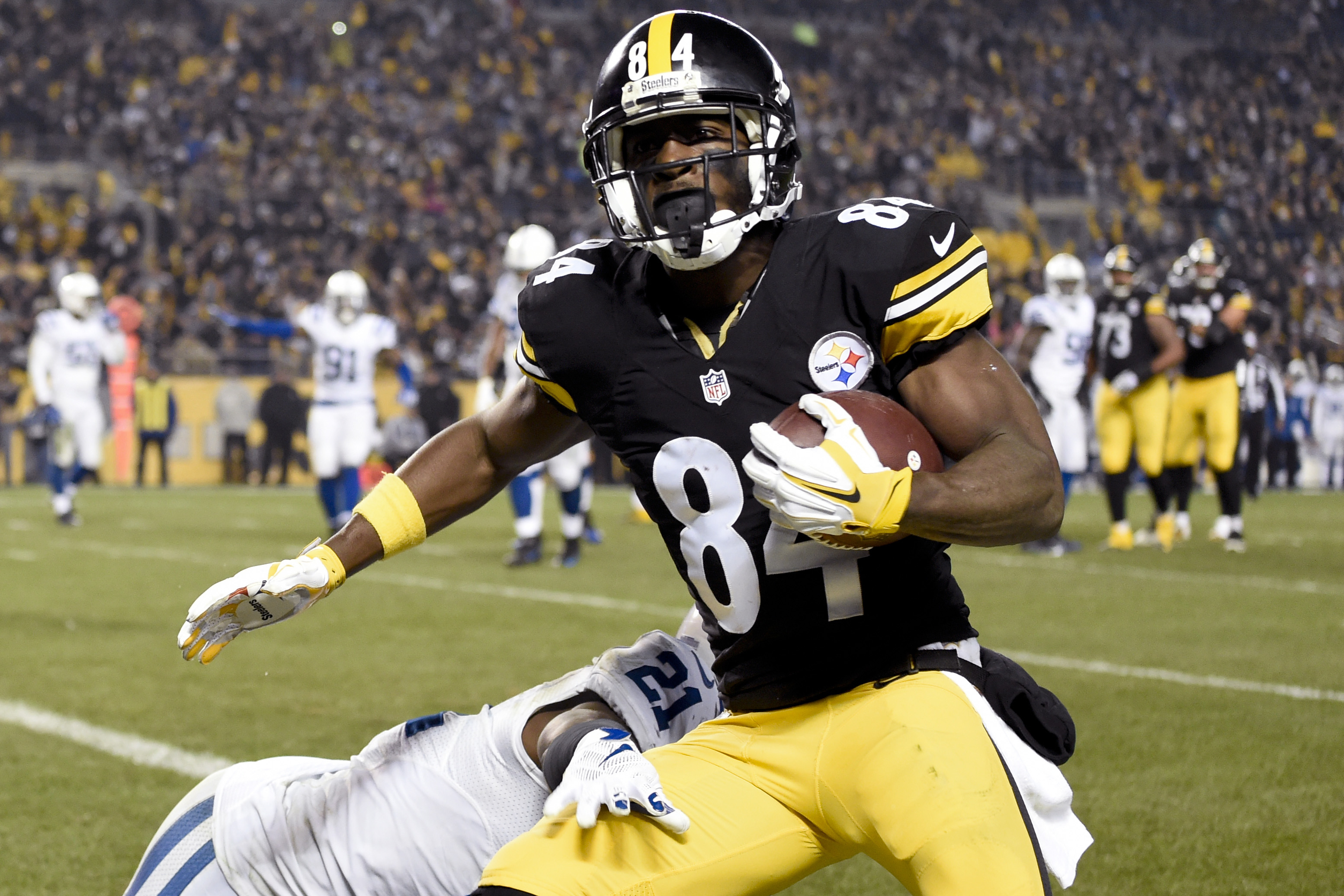 FILE - In this file photo from Dec. 6, 2015, Pittsburgh Steelers wide receiver Antonio Brown (84) catches a touchdown pass from quarterback Ben Roethlisberger with  Indianapolis Colts cornerback Vontae Davis (21) defending during the first half of an NFL