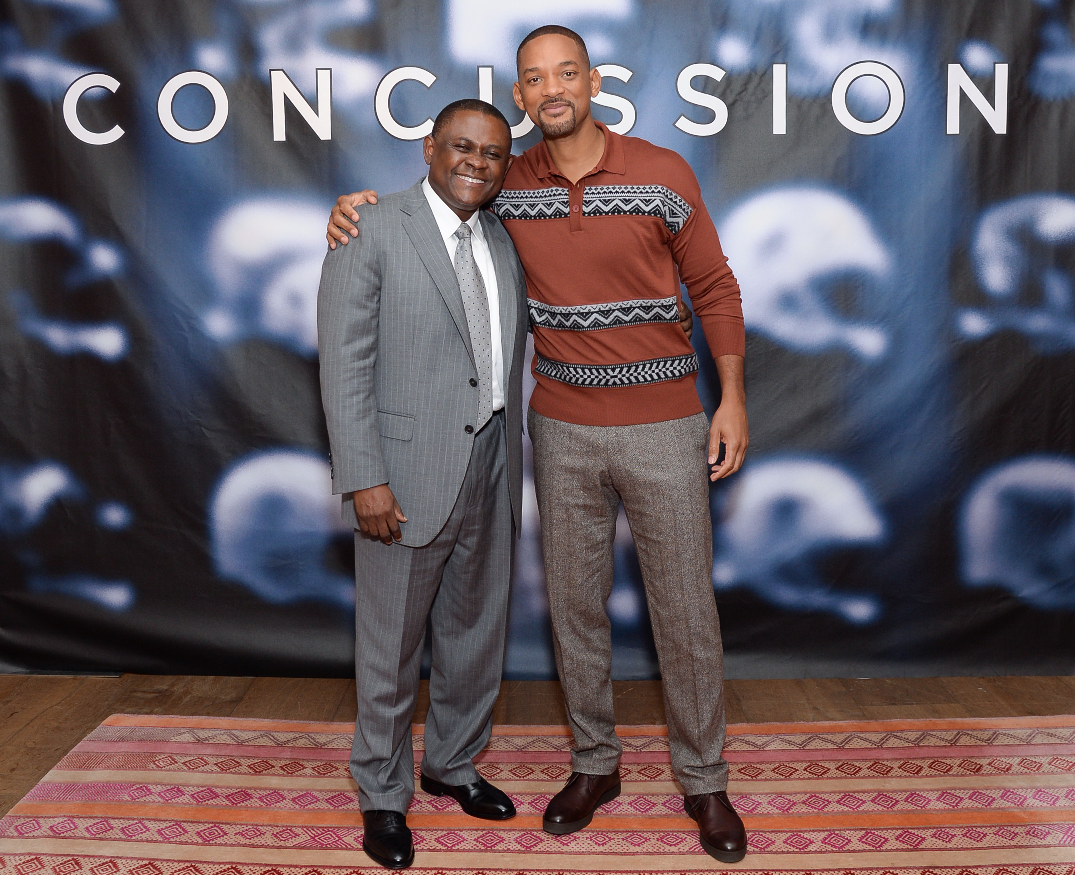 "FILE - In this Dec. 14, 2015, file photo, Dr. Bennet Omalu, left, and actor Will Smith pose together at the cast photo call for the film ""Concussion"" at The Crosby Street Hotel in New York. In the trailer for the movie ""Concussion,"" Will Smith, portraying"