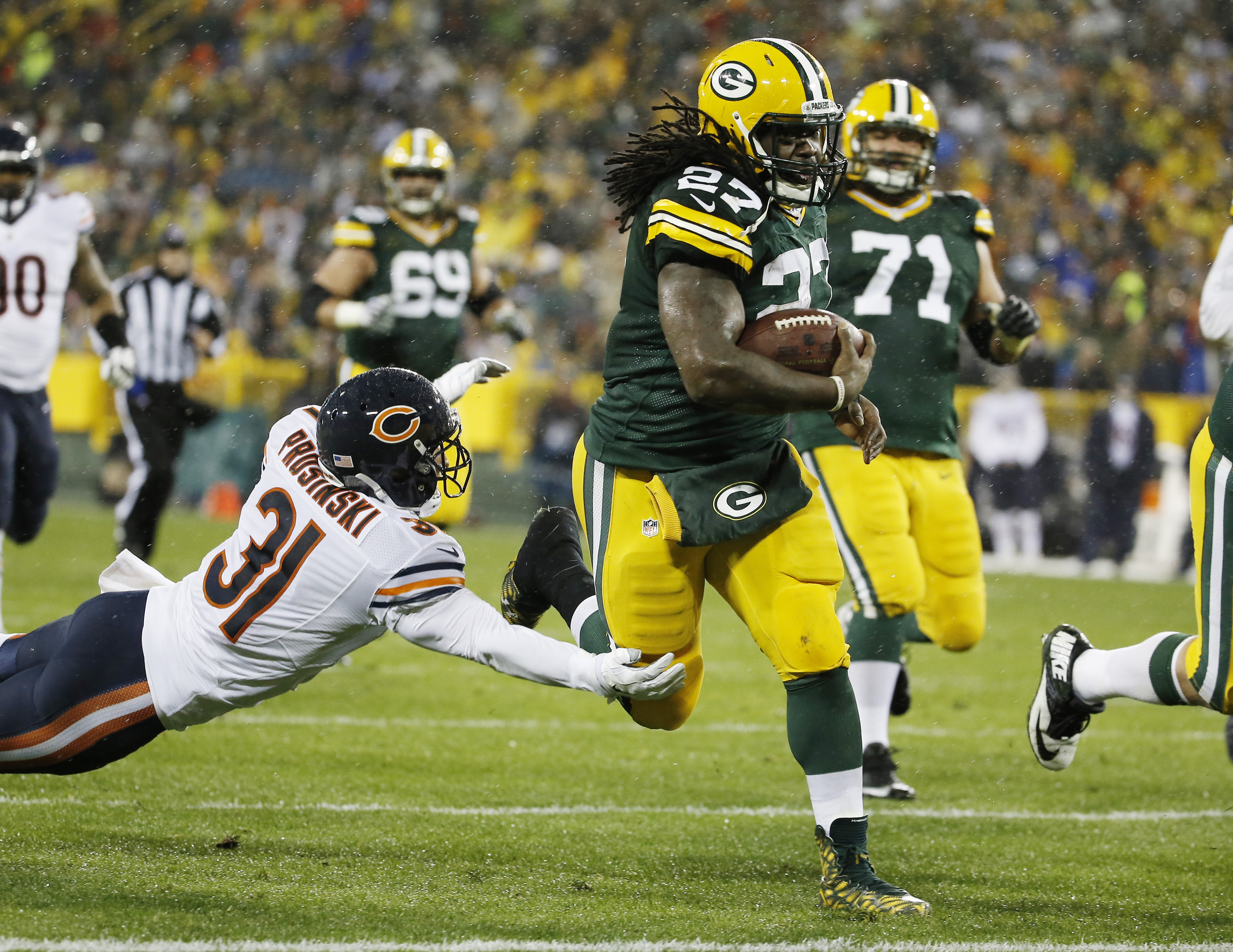 FILE - In this Nov. 26, 2015, file photo, Green Bay Packers' Eddie Lacy runs for a touchdown during the first half of an NFL football game against the Chicago Bears, in Green Bay, Wis. Lacy got a fresh start and ran all over the Dallas Cowboys. Now the go