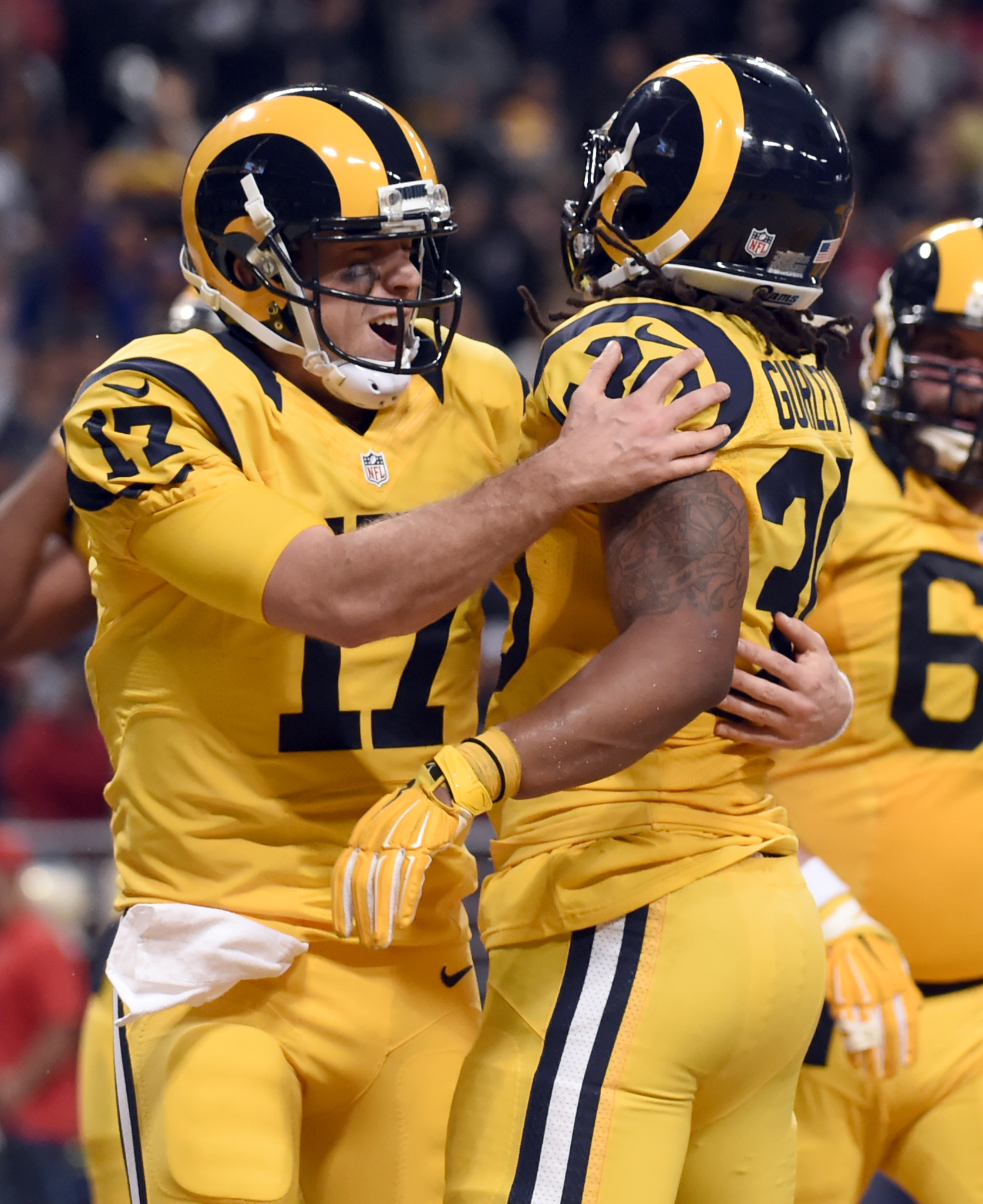St. Louis Rams running back Todd Gurley, right, is congratulated by quarterback Case Keenum after scoring on a 3-yard run during the second quarter of an NFL football game against the Tampa Bay Buccaneers on Thursday, Dec. 17, 2015, in St. Louis. (AP Phot
