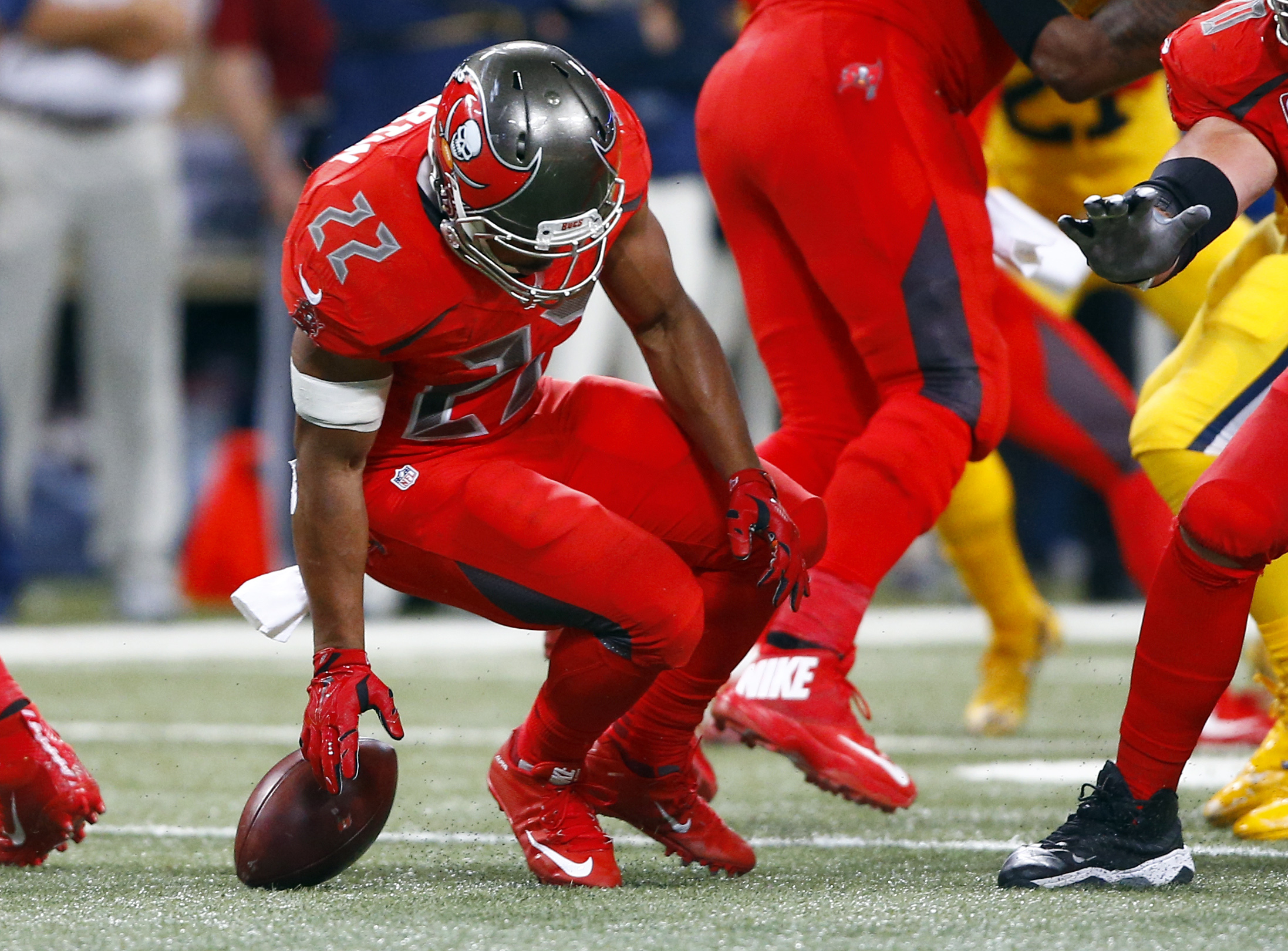 Tampa Bay Buccaneers running back Doug Martin fumbles the ball during the third quarter of an NFL football game against the St. Louis Rams on Thursday, Dec. 17, 2015, in St. Louis. The Rams' Doug Worthington recovered the fumble. (AP Photo/Billy Hurst)