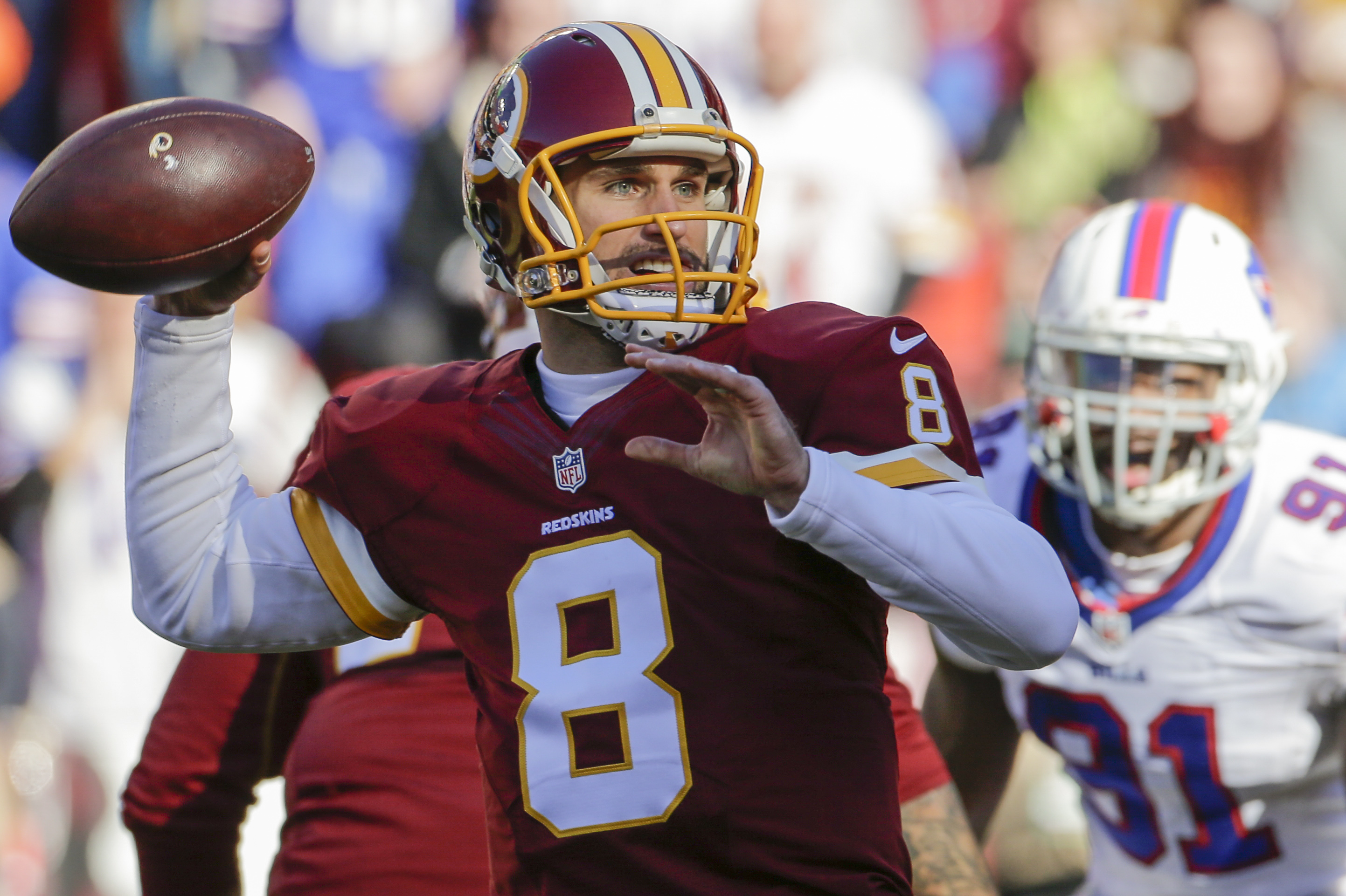 Washington Redskins quarterback Kirk Cousins (8) passes the ball during the first half of an NFL football game against the Buffalo Bills in Landover, Md., Sunday, Dec. 20, 2015. (AP Photo/Mark Tenally)