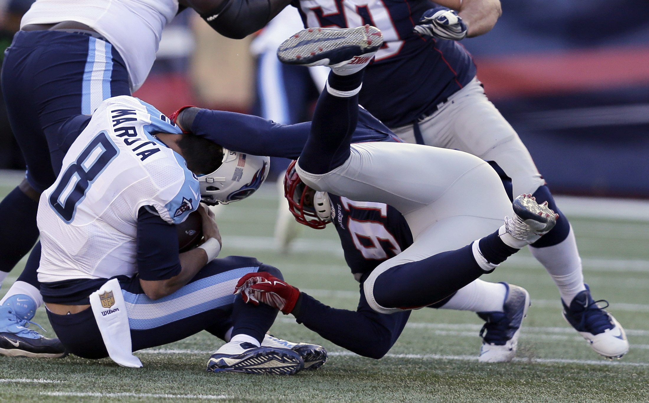 New England Patriots linebacker Jamie Collins (91) sacks Tennessee Titans quarterback Marcus Mariota (8) in the first half of an NFL football game, Sunday, Dec. 20, 2015, in Foxborough, Mass. Mariota was injured on the play.  (AP Photo/Charles Krupa)