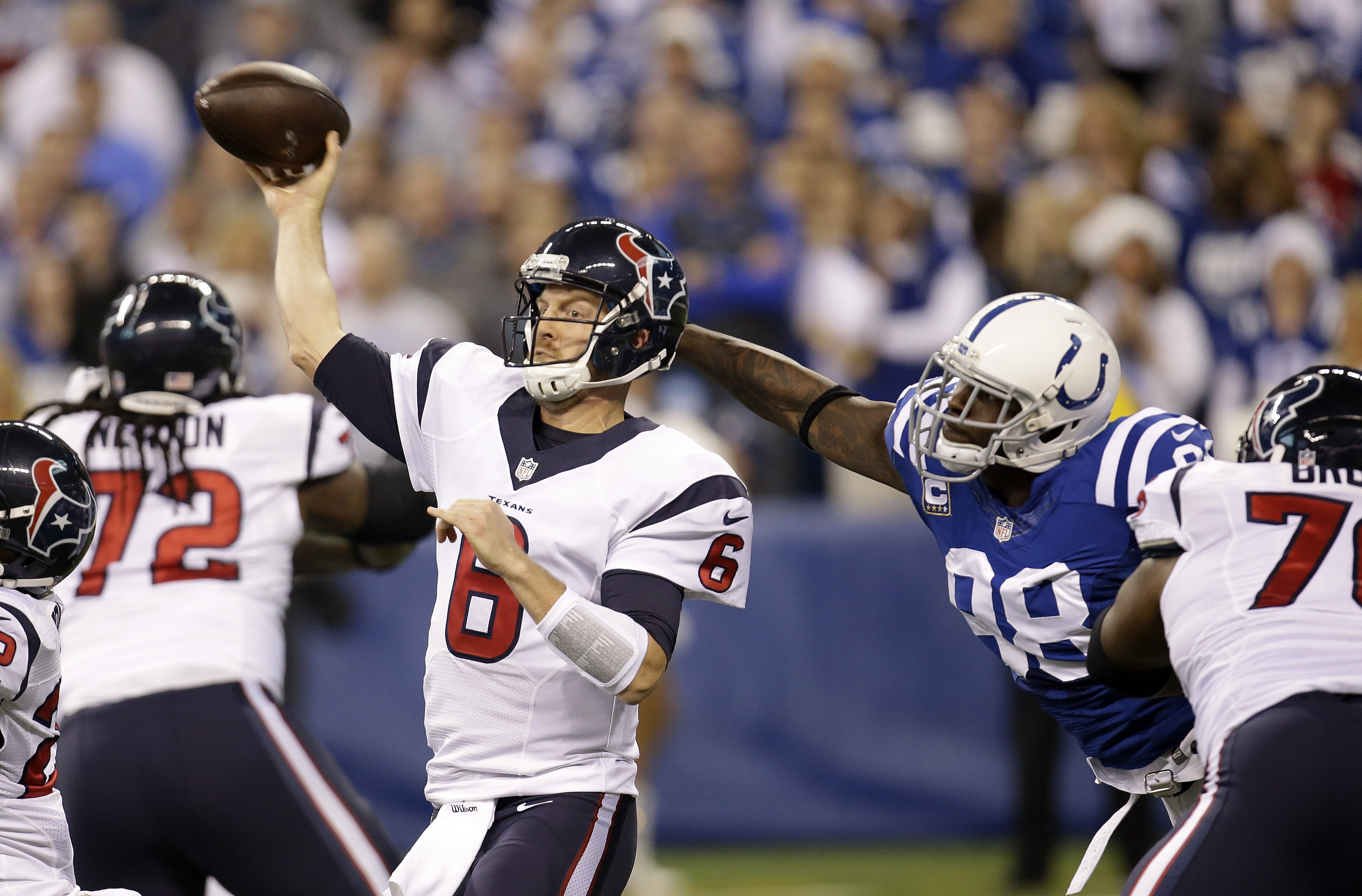 Houston Texans' T.J. Yates (6) throws while being pressured by Indianapolis Colts' Robert Mathis (98) during the first half of an NFL football game, Sunday, Dec. 20, 2015, in Indianapolis. (AP Photo/AJ Mast)