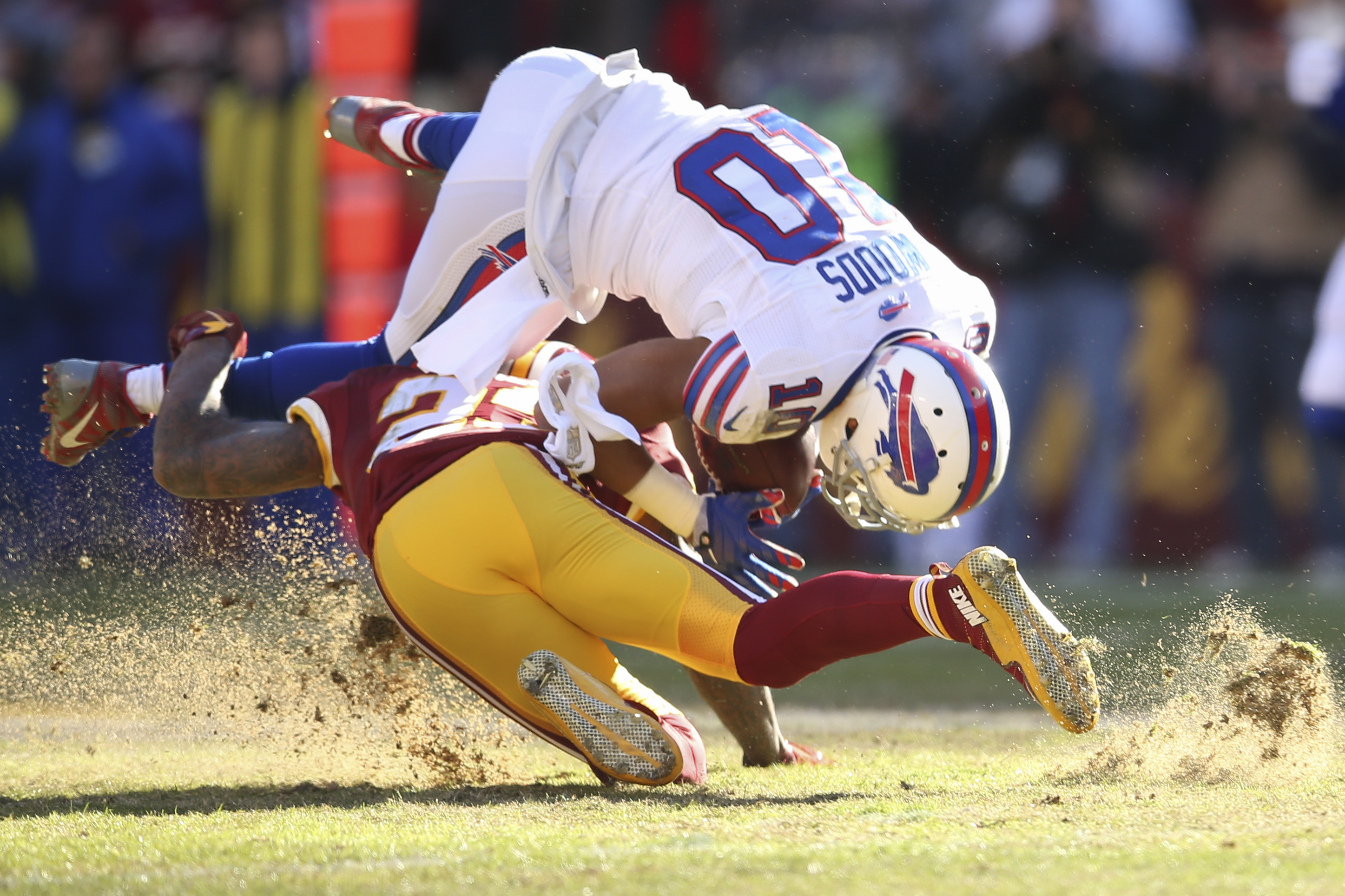 Buffalo Bills wide receiver Robert Woods (10) is upended by Washington Redskins defensive back DeAngelo Hall (23) during the first half of an NFL football game in Landover, Md., Sunday, Dec. 20, 2015. (AP Photo/Andrew Harnik)