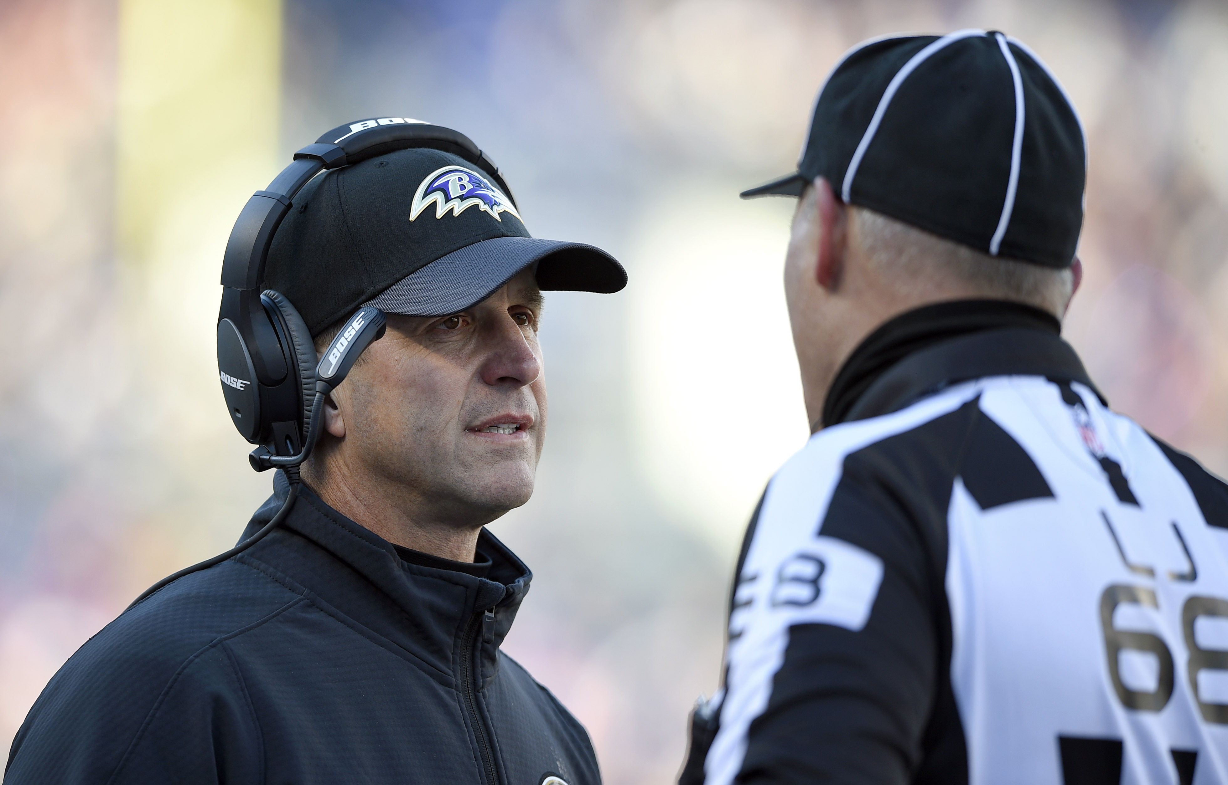 Baltimore Ravens head coach John Harbaugh, left, speaks with line judge Tom Stephan in the first half of an NFL football game against the Kansas City Chiefs, Sunday, Dec. 20, 2015, in Baltimore. (AP Photo/Nick Wass)