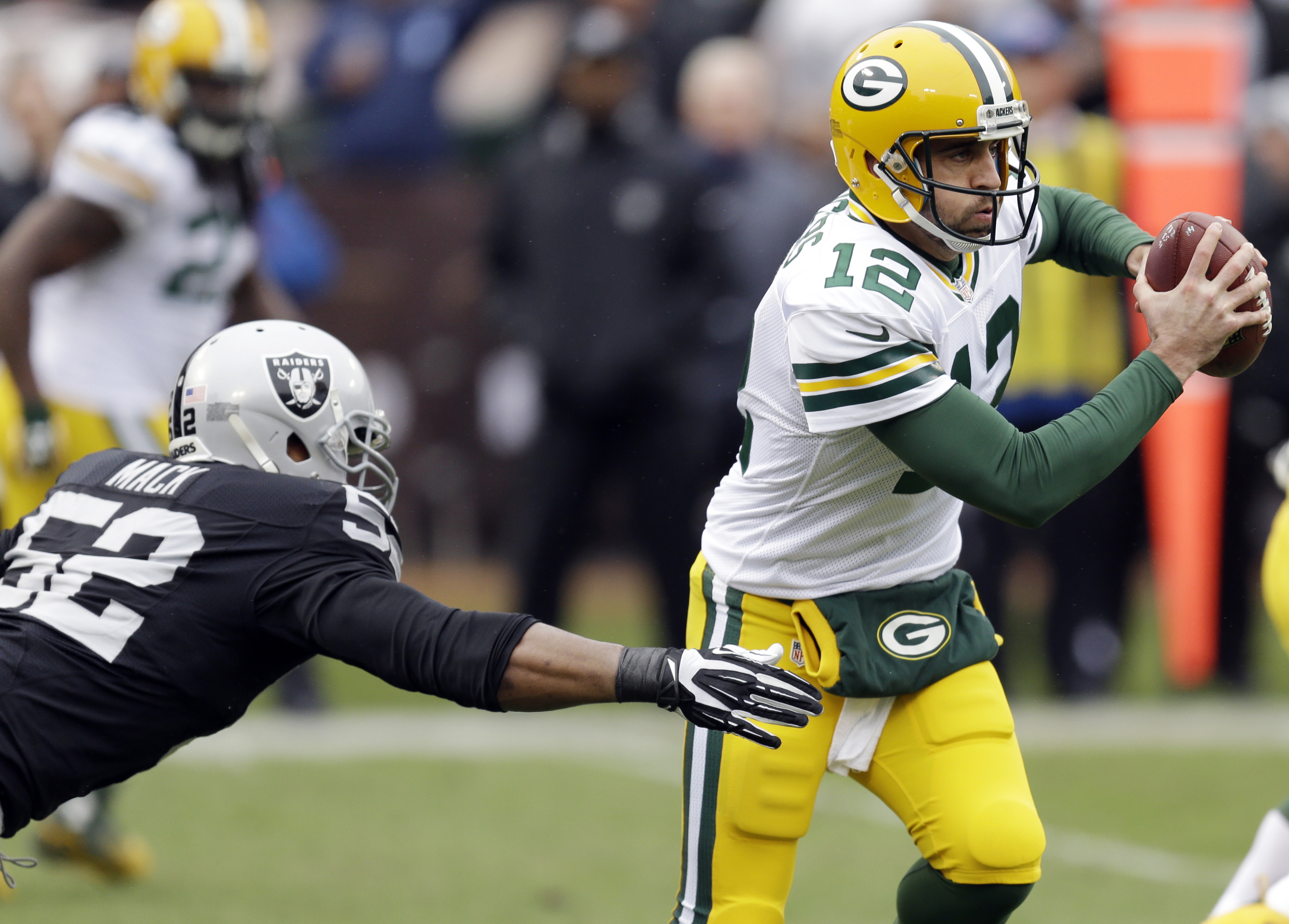 Green Bay Packers quarterback Aaron Rodgers (12) is sacked by Oakland Raiders defensive end Khalil Mack (52) during the first half of an NFL football game Sunday, Dec. 20, 2015, in Oakland, Calif. (AP Photo/Ben Margot)
