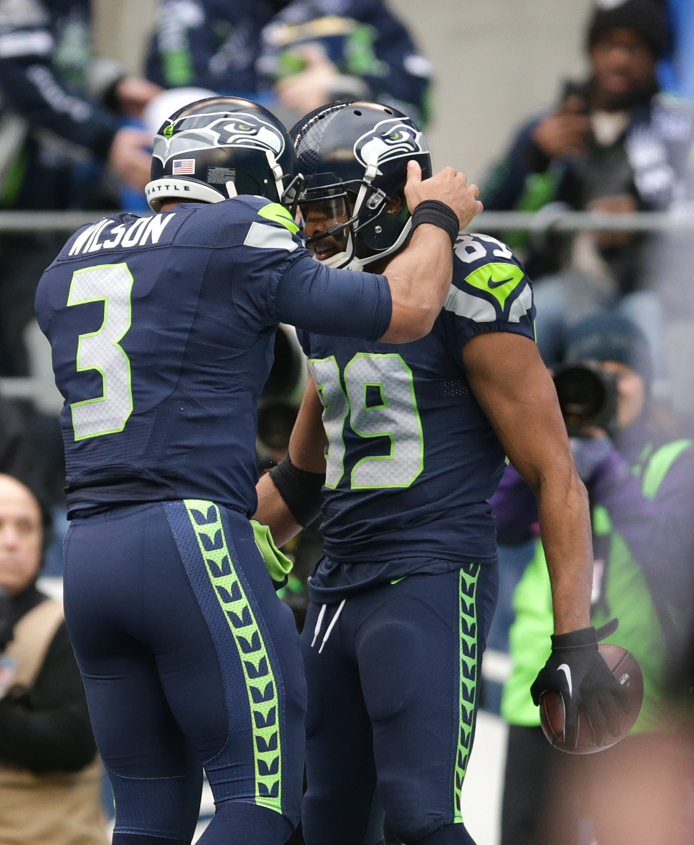 Seattle Seahawks quarterback Russell Wilson (3) congratulates Doug Baldwin after Wilson's touchdown pass to Baldwin against the Cleveland Browns in the first half of an NFL football game, Sunday, Dec. 20, 2015, in Seattle. (AP Photo/Scott Eklund)