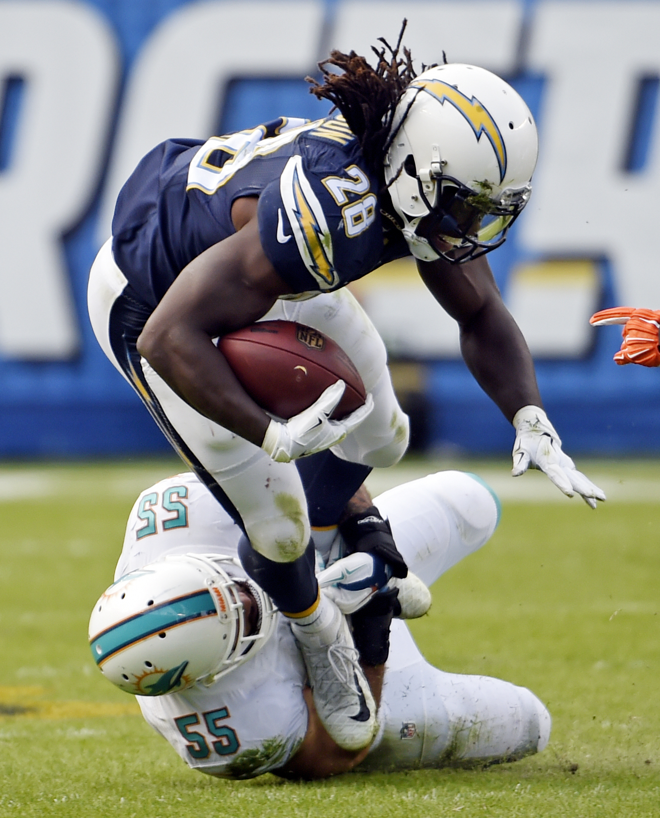 San Diego Chargers running back Melvin Gordon, top, is tackled by Miami Dolphins outside linebacker Koa Misi during the first half in an NFL football game, Sunday, Dec. 20, 2015, in San Diego. (AP Photo/Denis Poroy)