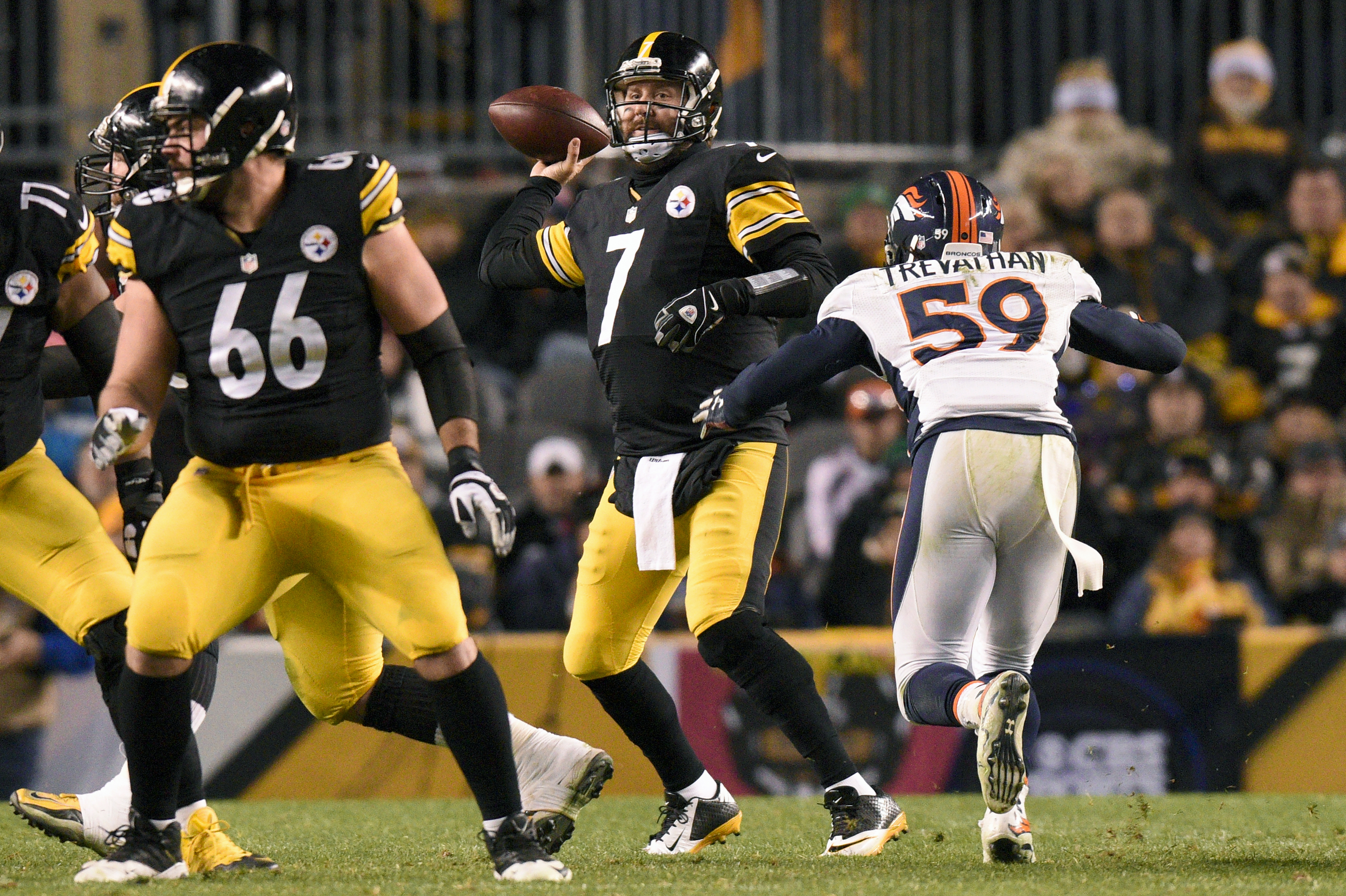 Pittsburgh Steelers quarterback Ben Roethlisberger (7) passes during the second half of an NFL football game under pressure by Denver Broncos inside linebacker Danny Trevathan (59) in Pittsburgh, Sunday, Dec. 20, 2015. (AP Photo/Don Wright)