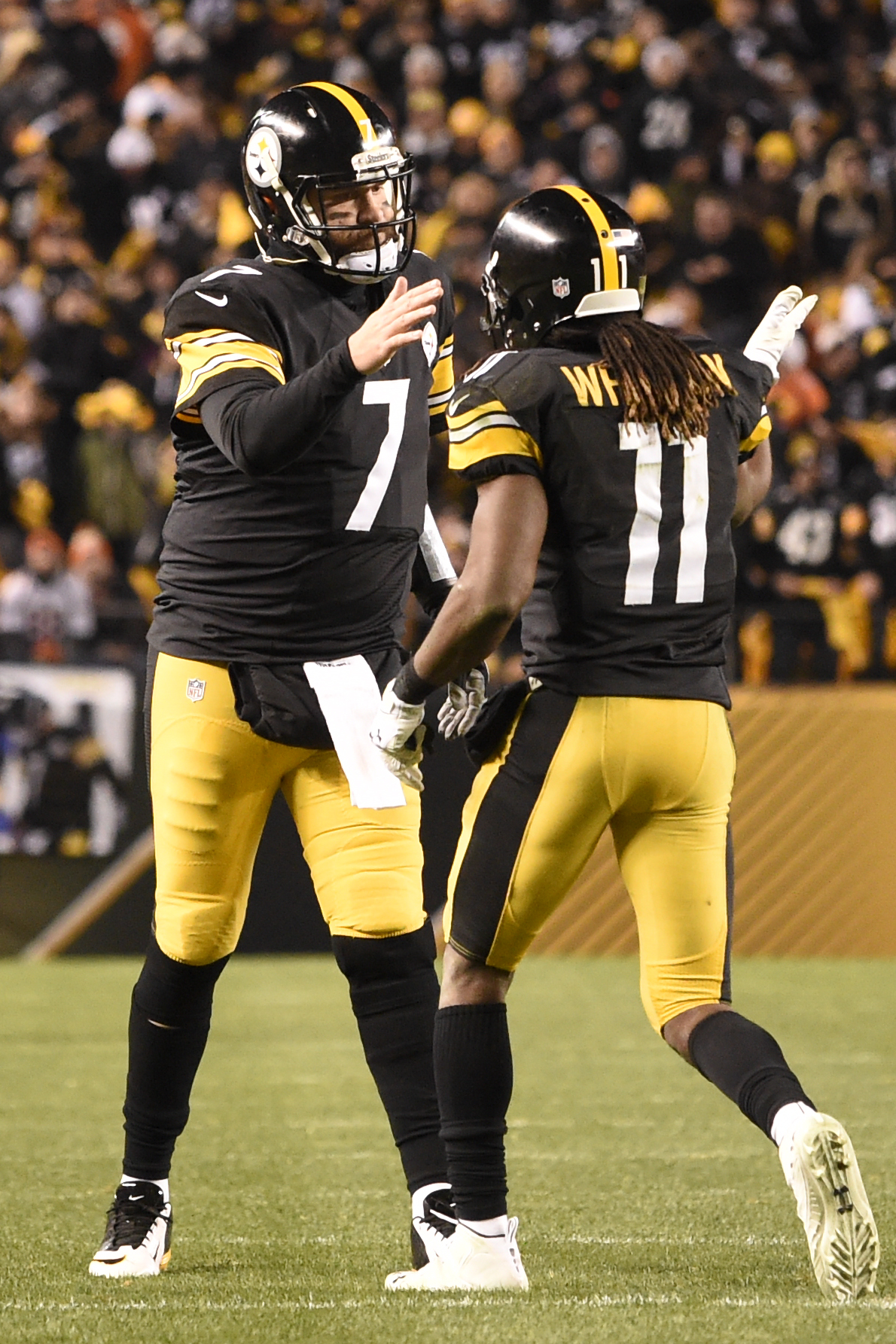 Pittsburgh Steelers wide receiver Markus Wheaton (11) celebrates with quarterback Ben Roethlisberger (7) after scoring the two connected on a touchdown pass during the second half of an NFL football game against the Denver Broncos in Pittsburgh, Sunday, D